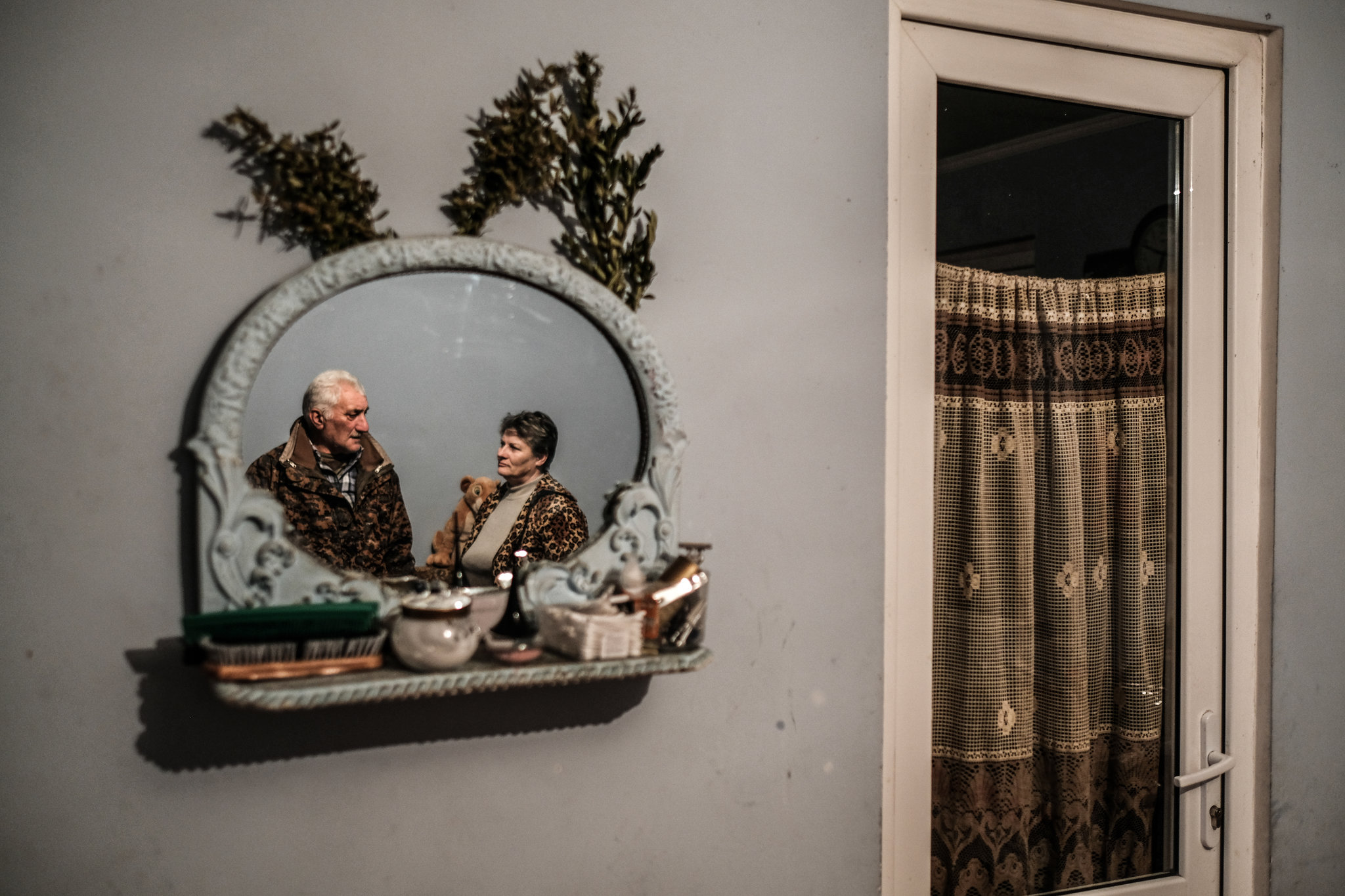 Galina Kelekhsaeva, whose heritage is Ossetian, with her husband, whose heritage is Georgian. They live in an I.D.P. settlement in the village of Shavshvebi.