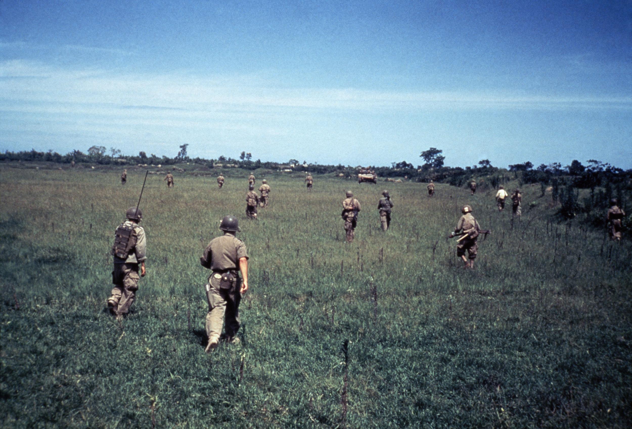 INDOCHINA. May 25, 1954. Vietnamese troops advancing between Namdinh and Thaibinh. Photo by Robert Capa © International Center of Photography/Magnum Photos