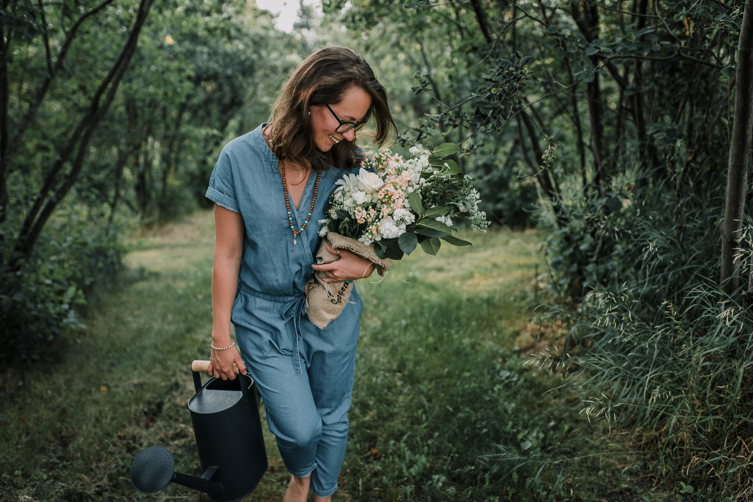 woman with flowers brand photography Edmonton by Sara Jewell Photography