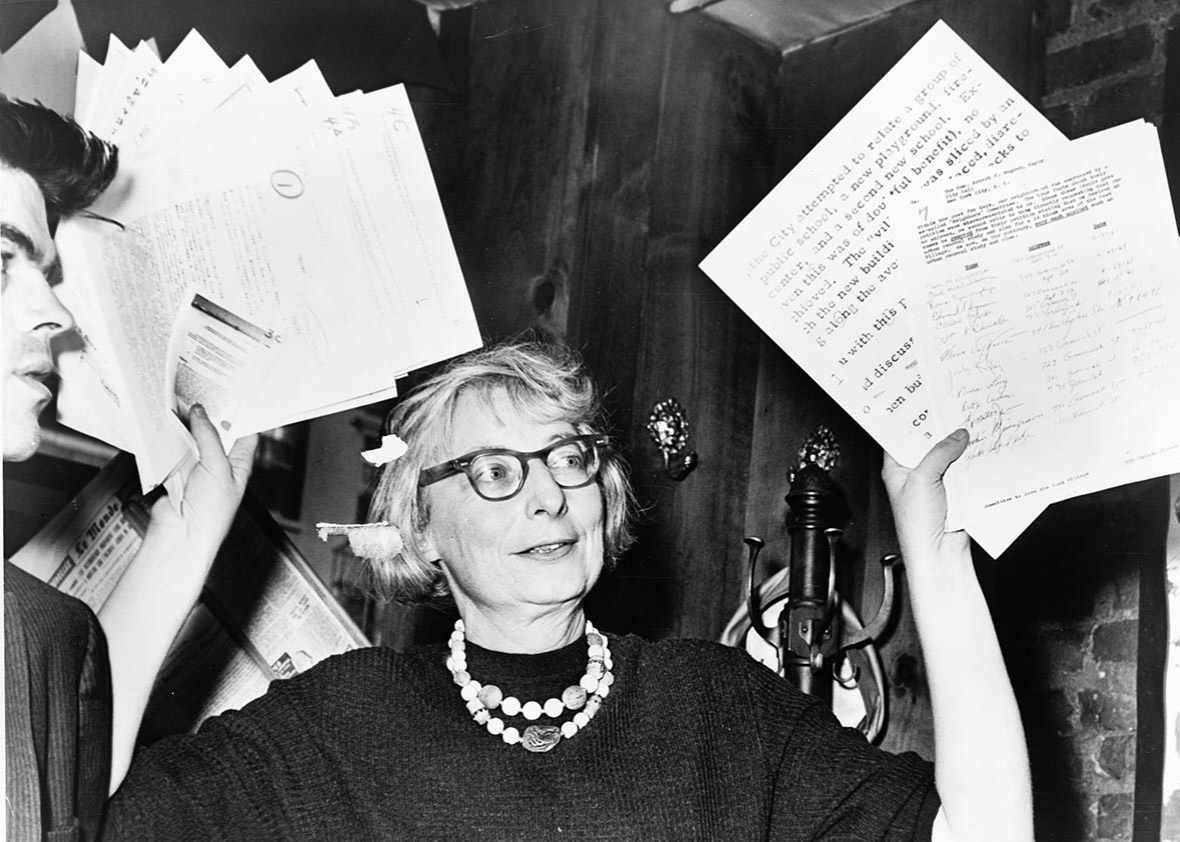 Jane Jacobs holds documents in support of the Committee to Save the West Village in New York in 1961. Library of Congress.