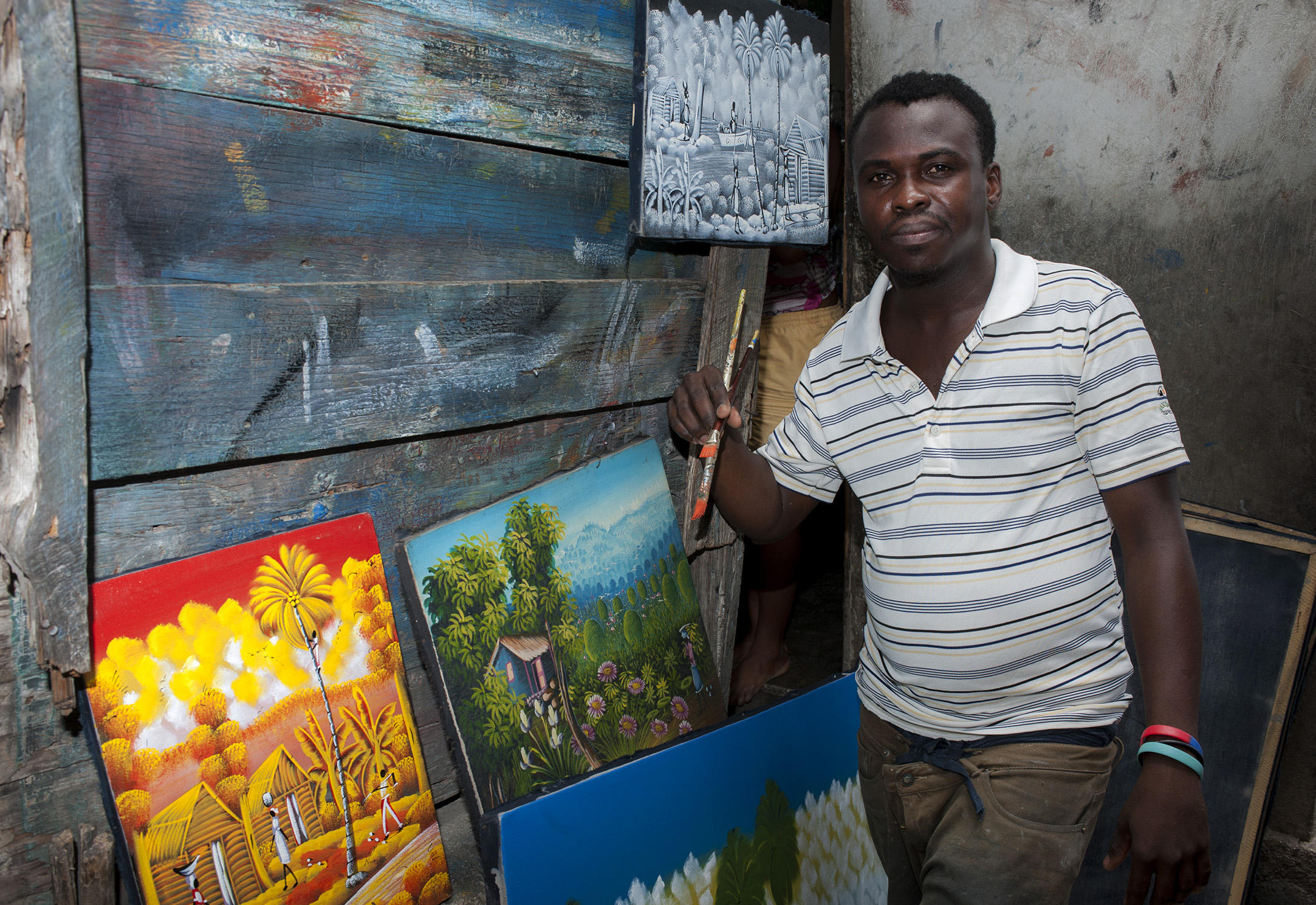 """Claudy Petion  34 years old  """"I learned to paint when I was a young from the older boys in the area. They said I was good and so I just kept painting."""""""