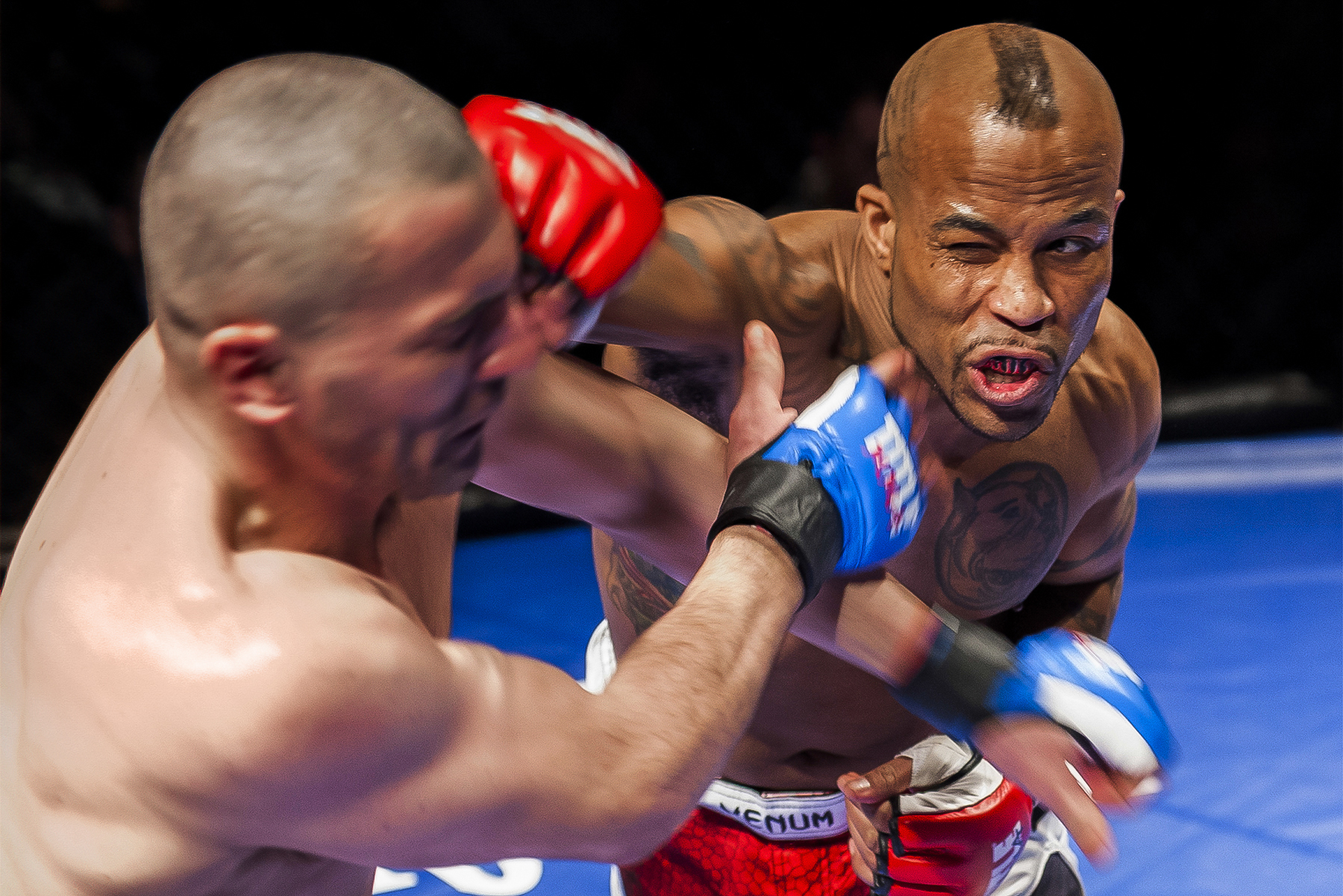 Amateur MMA fighter Talmadge Lytle strikes a blow against Raymond Gillies while in the cage at the LC Pavilion in Columbus, Ohio, during the Arnold Sports Festival on March 1, 2013.
