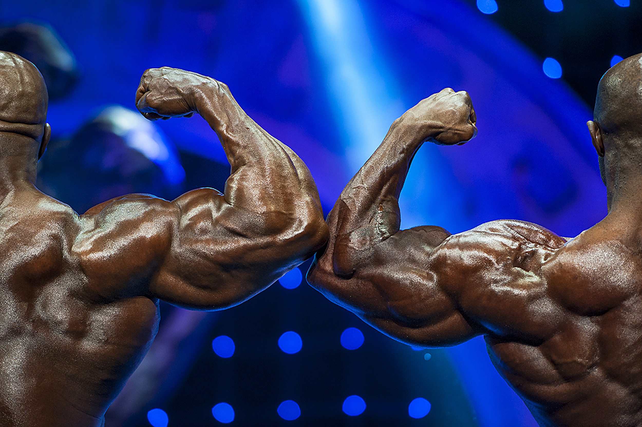 Professional bodybuilders Cedric McMillian (left) and Brandon Curry (right) show off their back muscles for the judges while on stage at the Veterans Memorial Auditorium in Columbus, Ohio, during the 26th annual IFBB Arnold Classic on March 1, 2014.