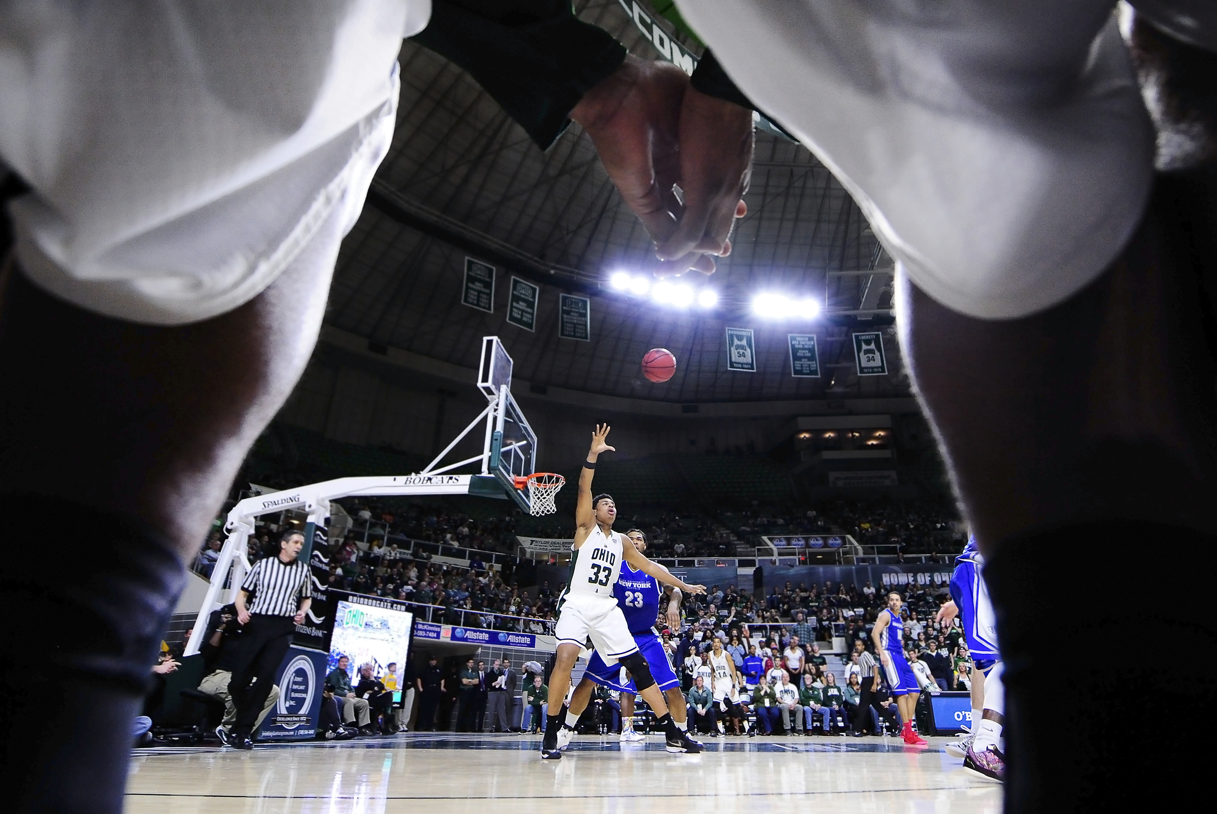 Ohio University center Anthony Campbell reaches for a high pass down under the basket during their game against the University of Buffalo on Jan. 24, 2015 in the Convocation Center in Athens, Ohio. The Bobcats would end up winning 63-61.