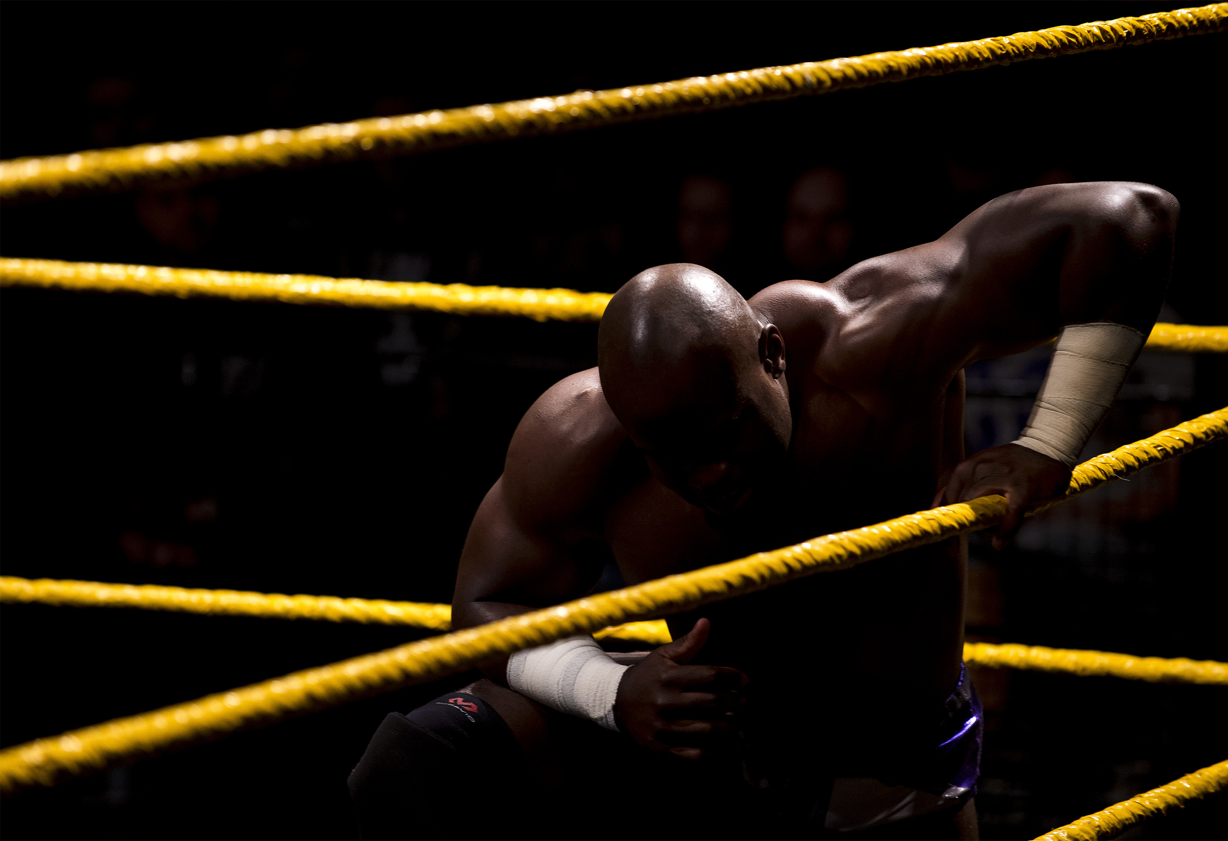 A WWE star takes a break on the ropes during a match in the LC Pavilion during the Arnold Sports Festival held in Columbus, Ohio.