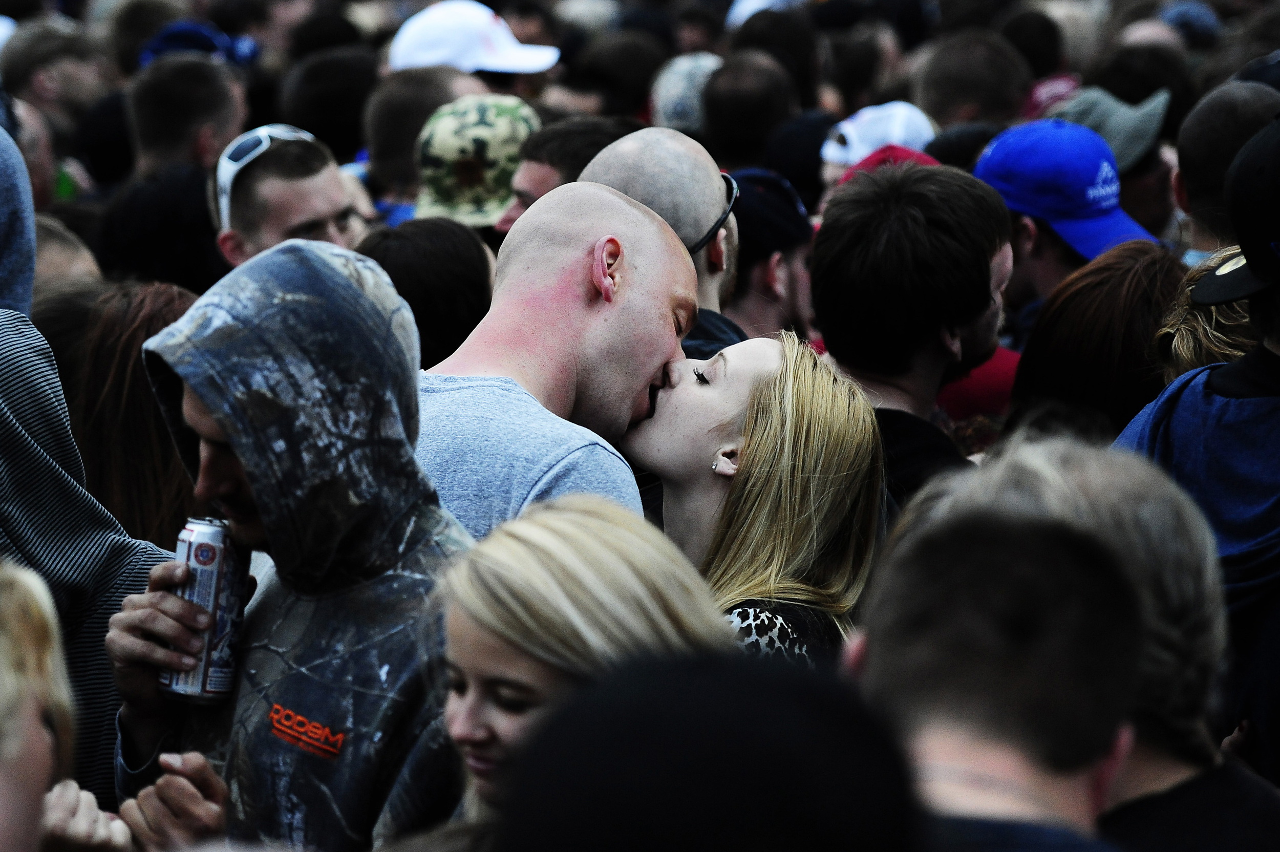A couple enjoy a quiet moment with each other among the crowd during the annual Rock on the Range music festival at the Columbus Crew Stadium on Friday, May 16, 2014. Over 103,000 people will have attended the event over the next three days.