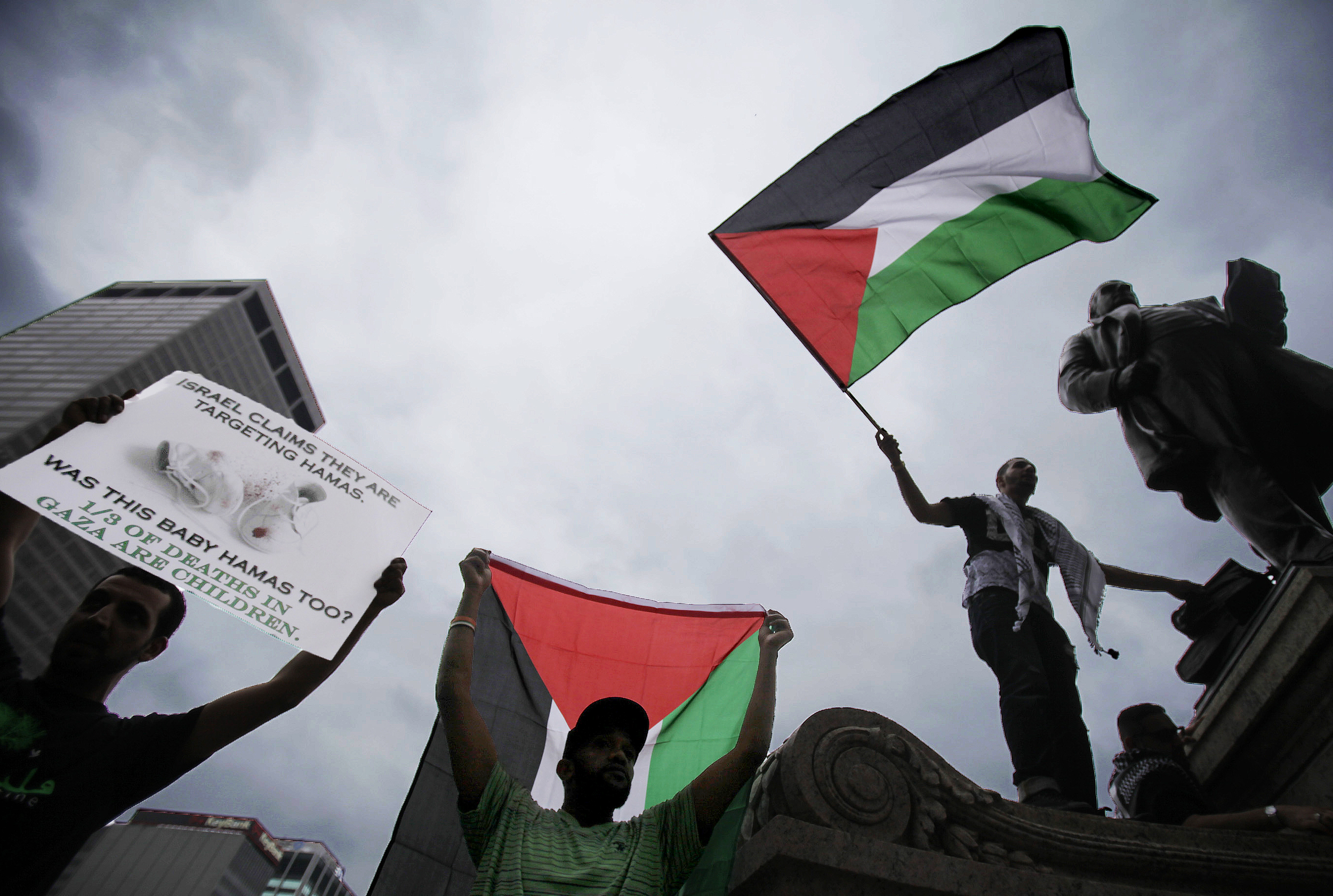 Demonstrators protest to free Gaza and Palestine in front of the Ohio Statehouse in downtown Columbus, Ohio, on Saturday, July 19, 2014.