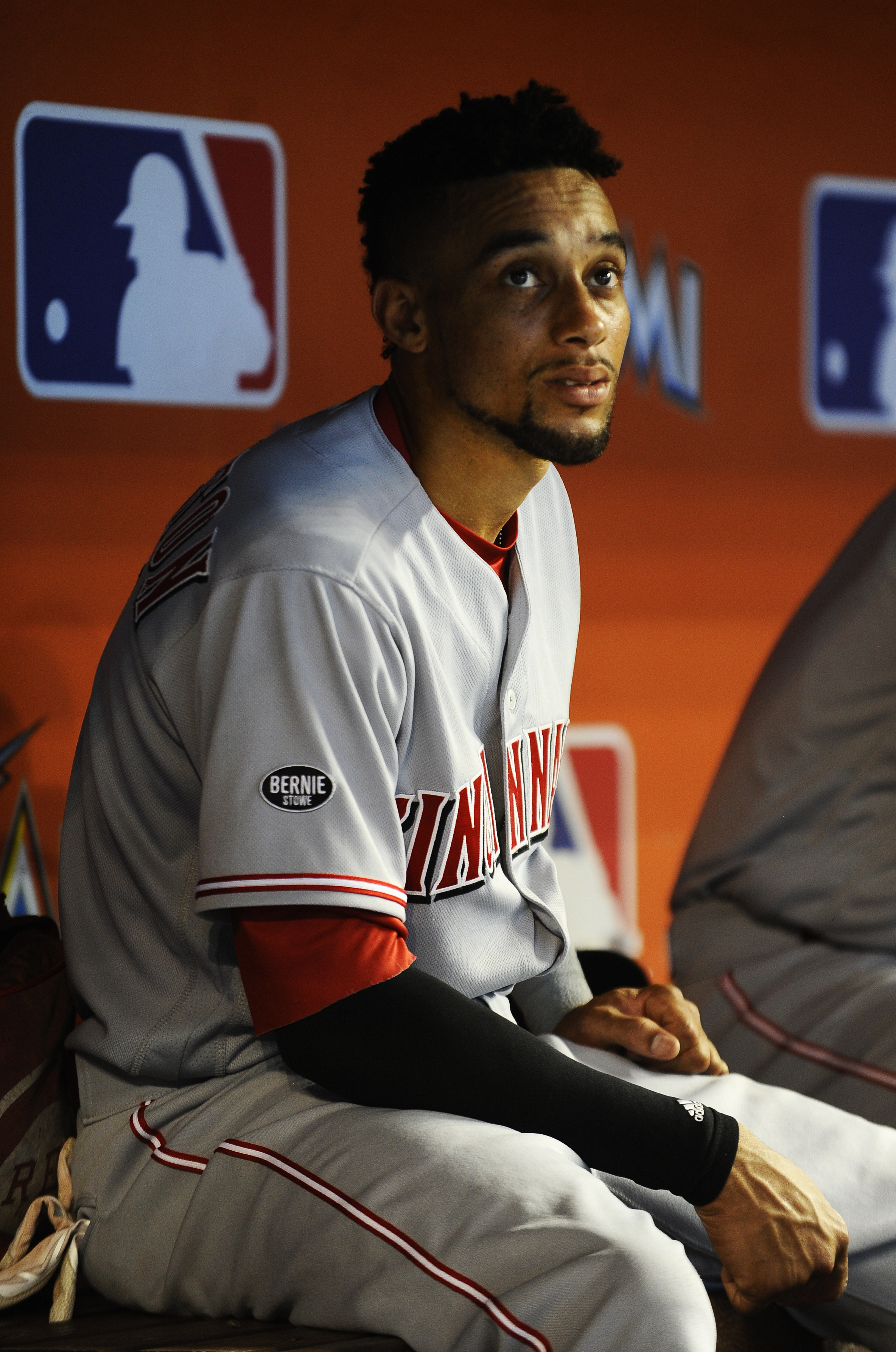 Cincinnati Reds center fielder Billy Hamilton (6) takes a look at the scoreboard while in the dugout during their game against the Miami Marlins at Marlins Stadium on July 10, 2016.