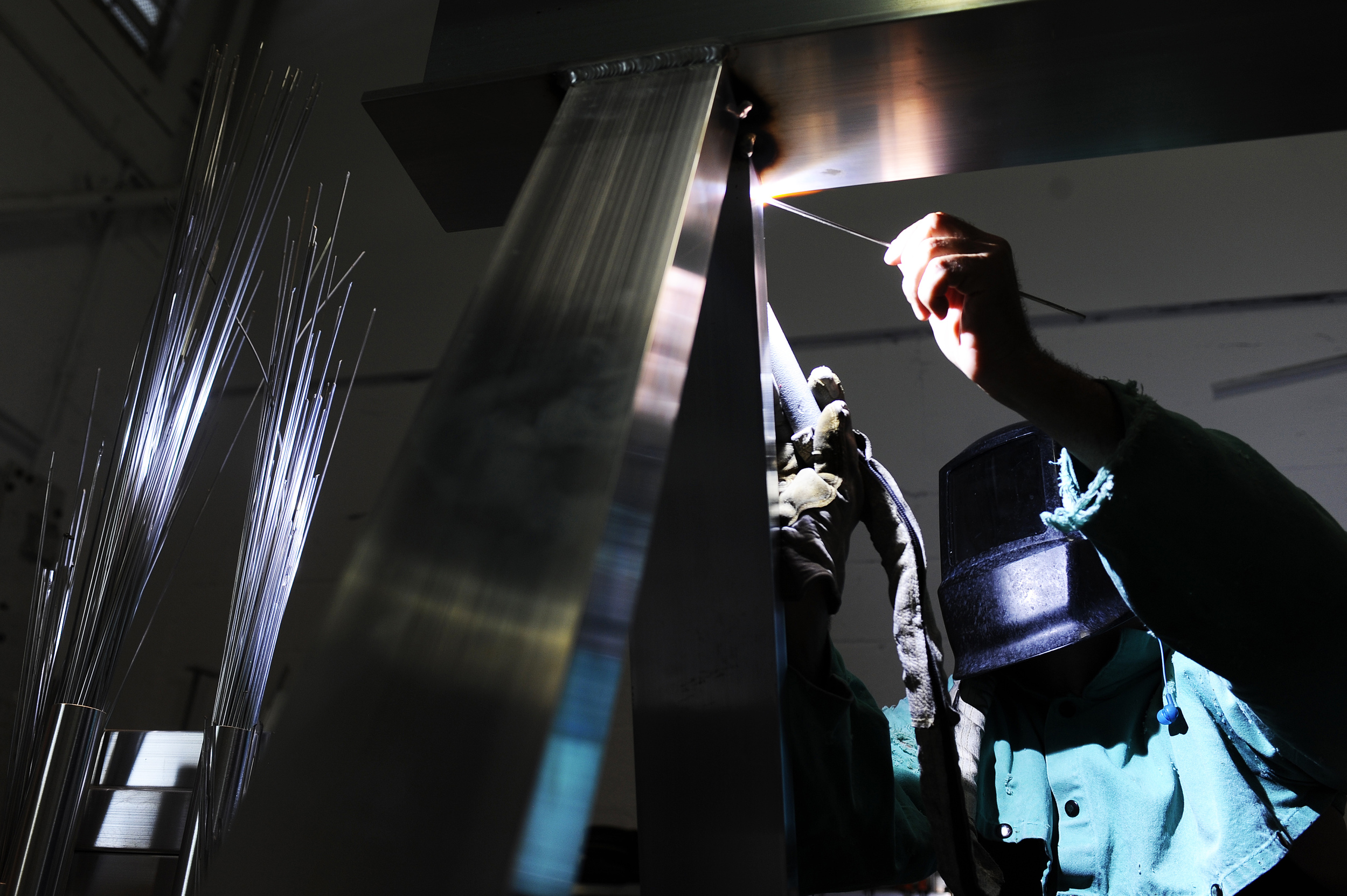 AccuDock worker Lou Jenks welds together pieces for a new floating dock inside their warehouse located in Pompano Beach, Florida. The family owned businessproduces floating docks, floating work platforms, swimming docks and related equipment for the recreational marine industry and for residential use.