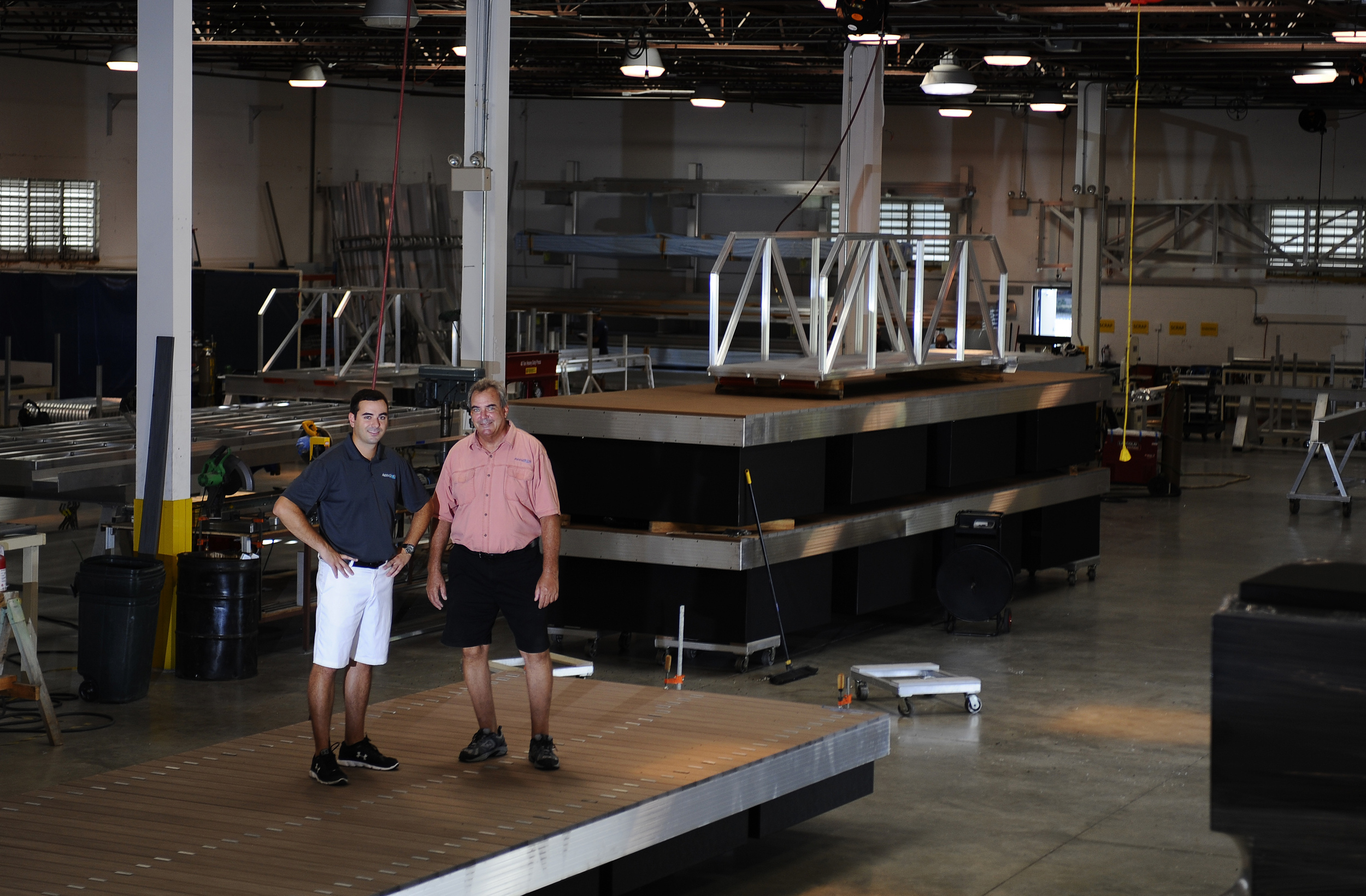 Father and son duo Johnand Jason Harrison pose for a portrait inside their warehouse located in Pompano Beach, Florida. The family owned businessproduces floating docks, floating work platforms, swimming docks and related equipment for the recreational marine industry and for residential use.