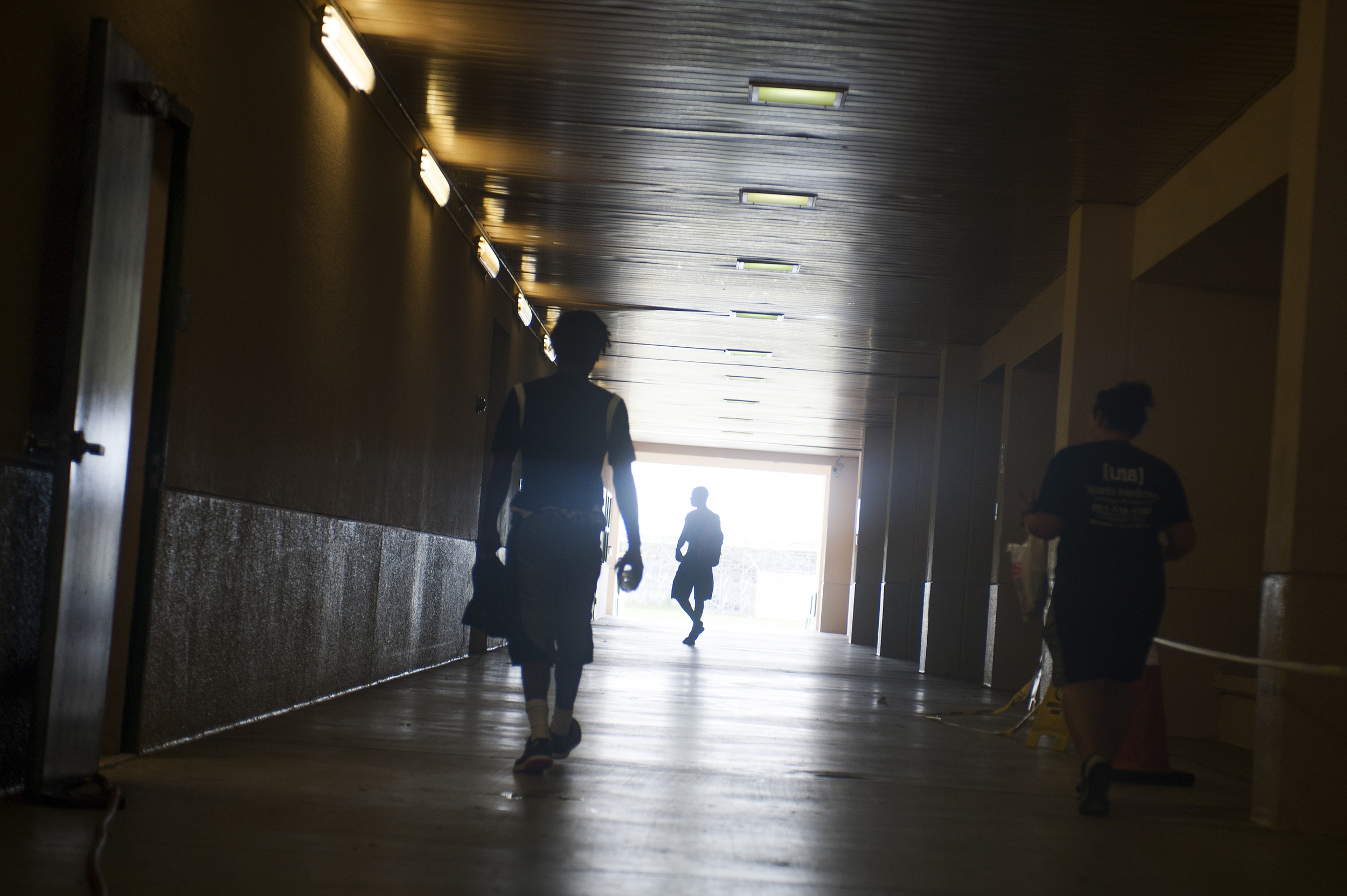 Flanagan high school football players make their way to the locker room prior to the start of the first practice of the high school season at Flanagan High School on Monday, Aug. 1, 2016. The reigning state champions look to repeat again despite the loss of key players from last year.