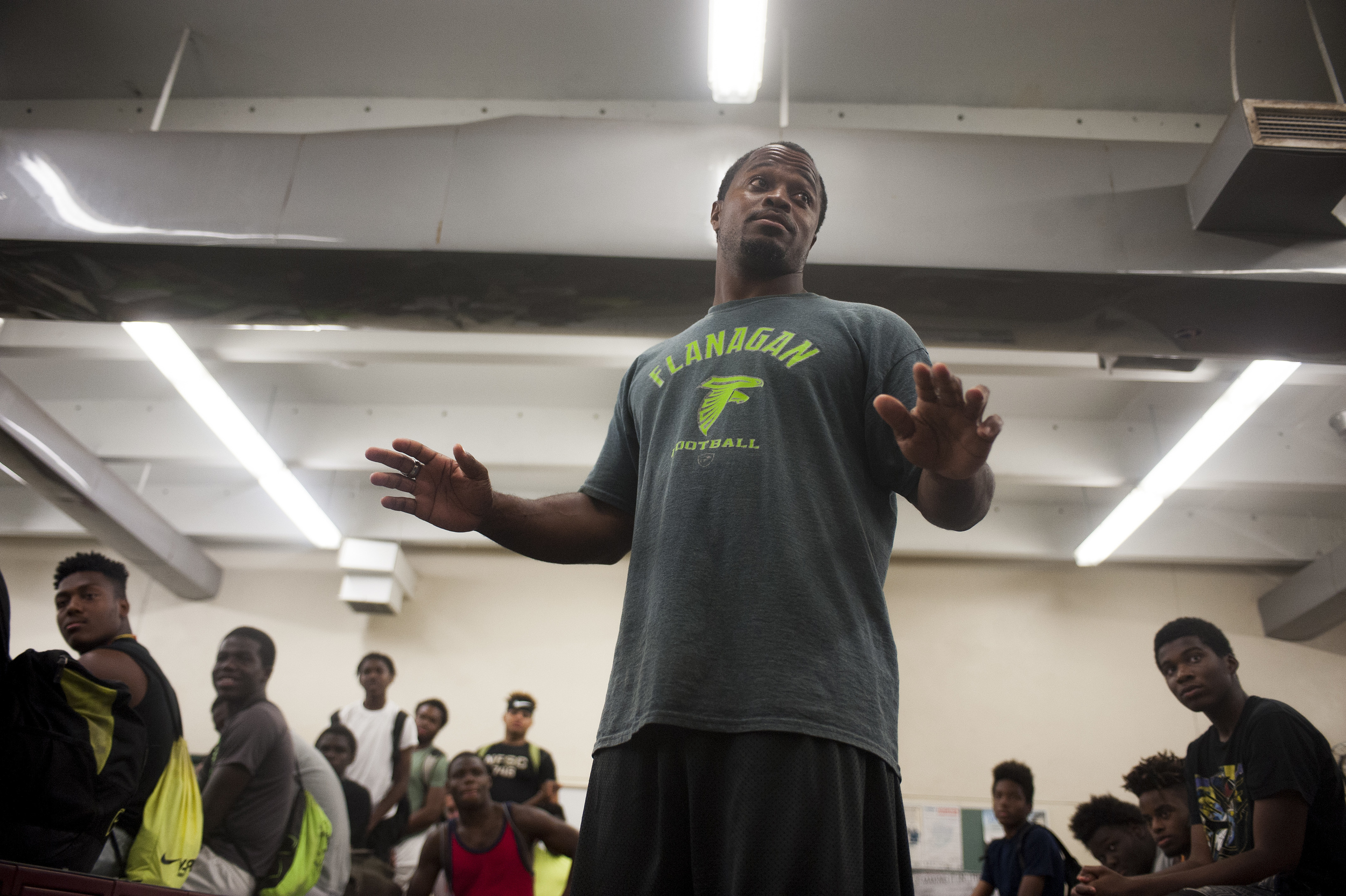 Flanagan high school head coach Stanford Samuel II talks to his team int he locker room during the first practice of the high school football season at Flanagan High School on Monday, Aug. 1, 2016. The reigning state champions look to repeat again despite the loss of key players from last year.