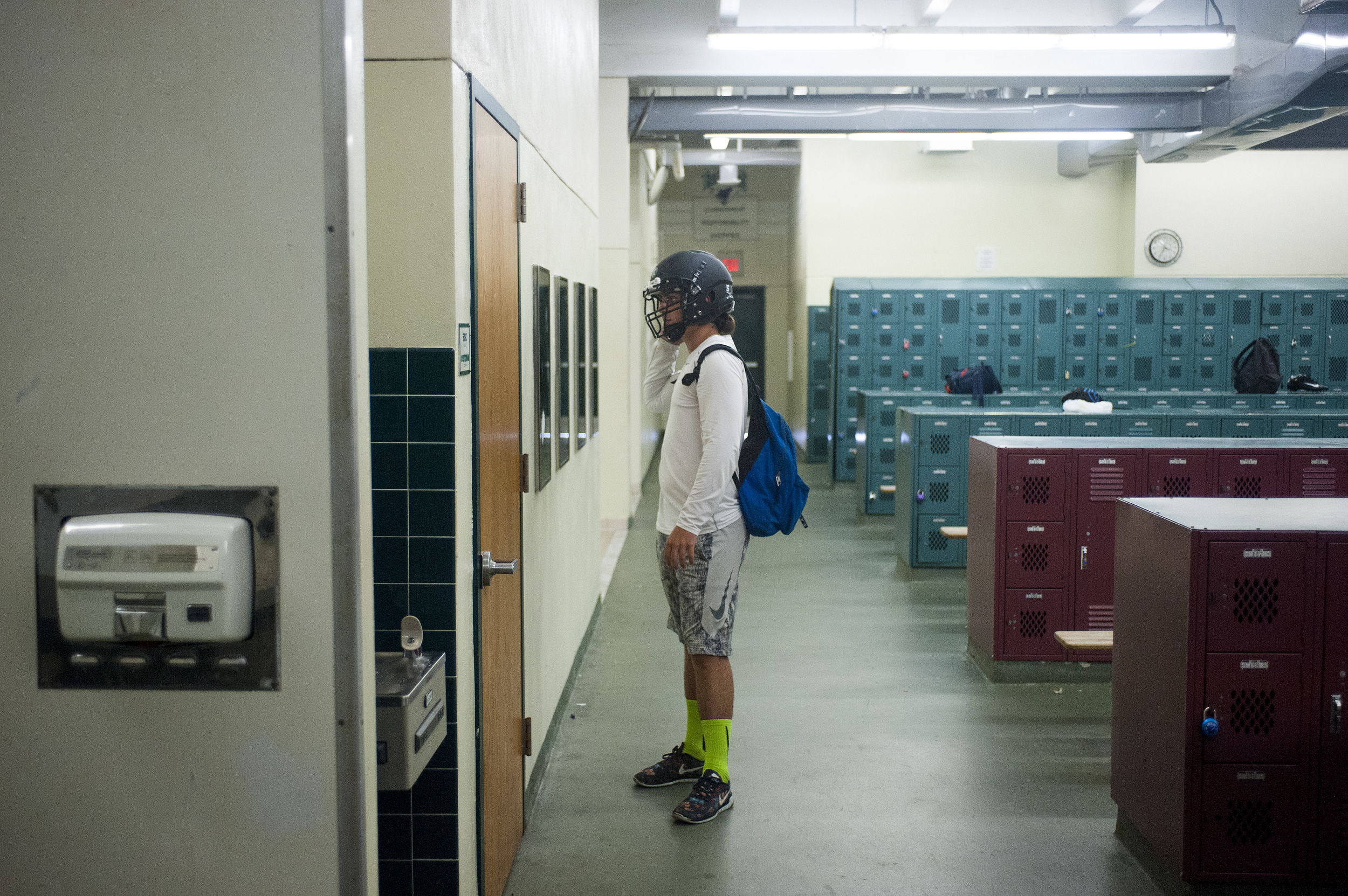 Flanagan high school junior linebacker Lucas Vallee looks at himself with his helmet on in the mirror inside the locker room prior to heading out to the field for the first practice of the high school football season at Flanagan High School on Monday, Aug. 1, 2016. The reigning state champions look to repeat again despite the loss of key players from last year.