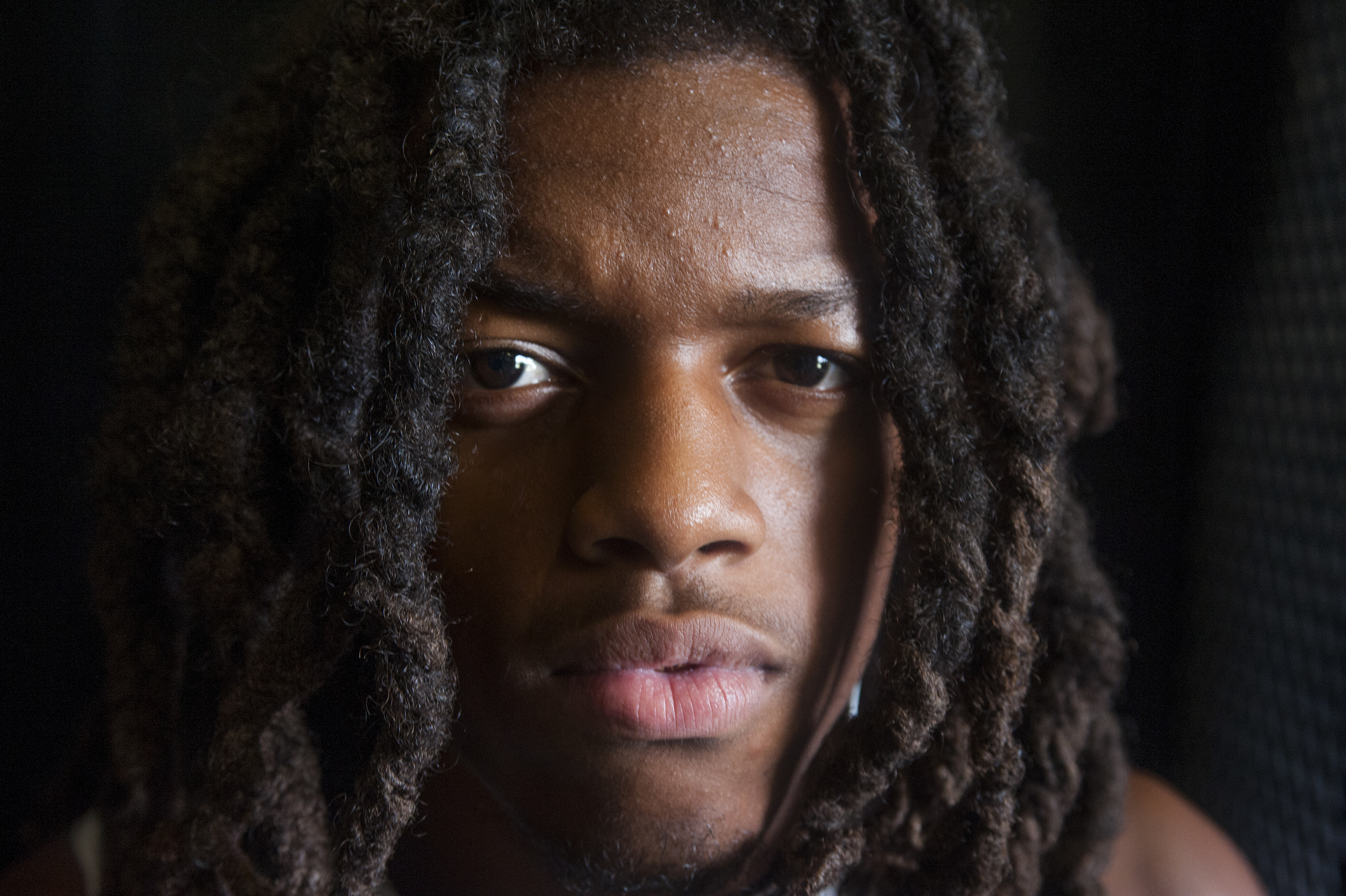 Flanagan high school senior wide receiver Caleb Thomas poses for a portrait while getting dressed for the first practice of the high school football season at Flanagan High School on Monday, Aug. 1, 2016. The reigning state champions look to repeat again despite the loss of key players from last year.