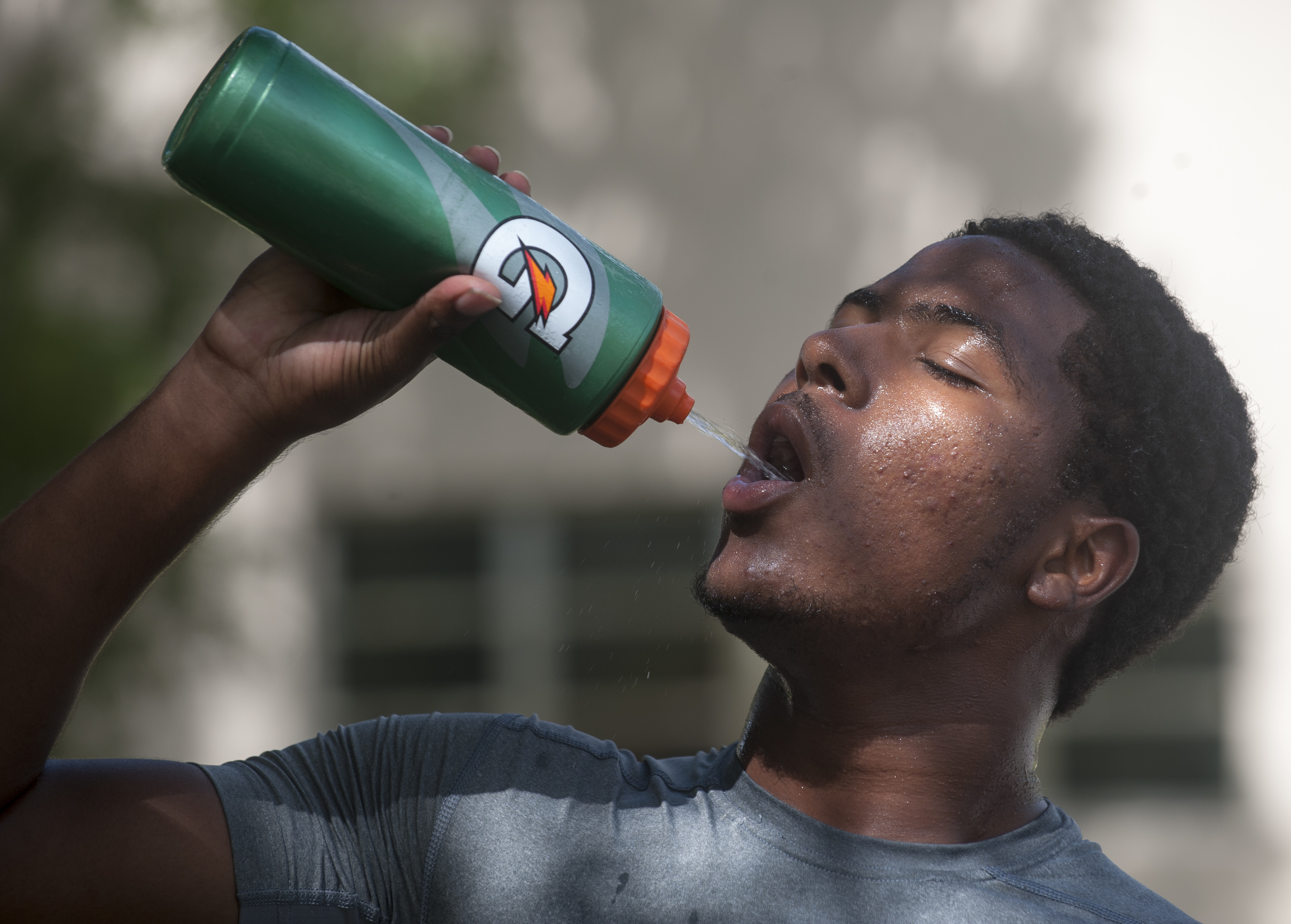 Flanagan high school junior wide receiver Shamar Nelson drinks water to cool off during the first practice of the high school football season at Flanagan High School on Monday, Aug. 1, 2016. The reigning state champions look to repeat again despite the loss of key players from last year.