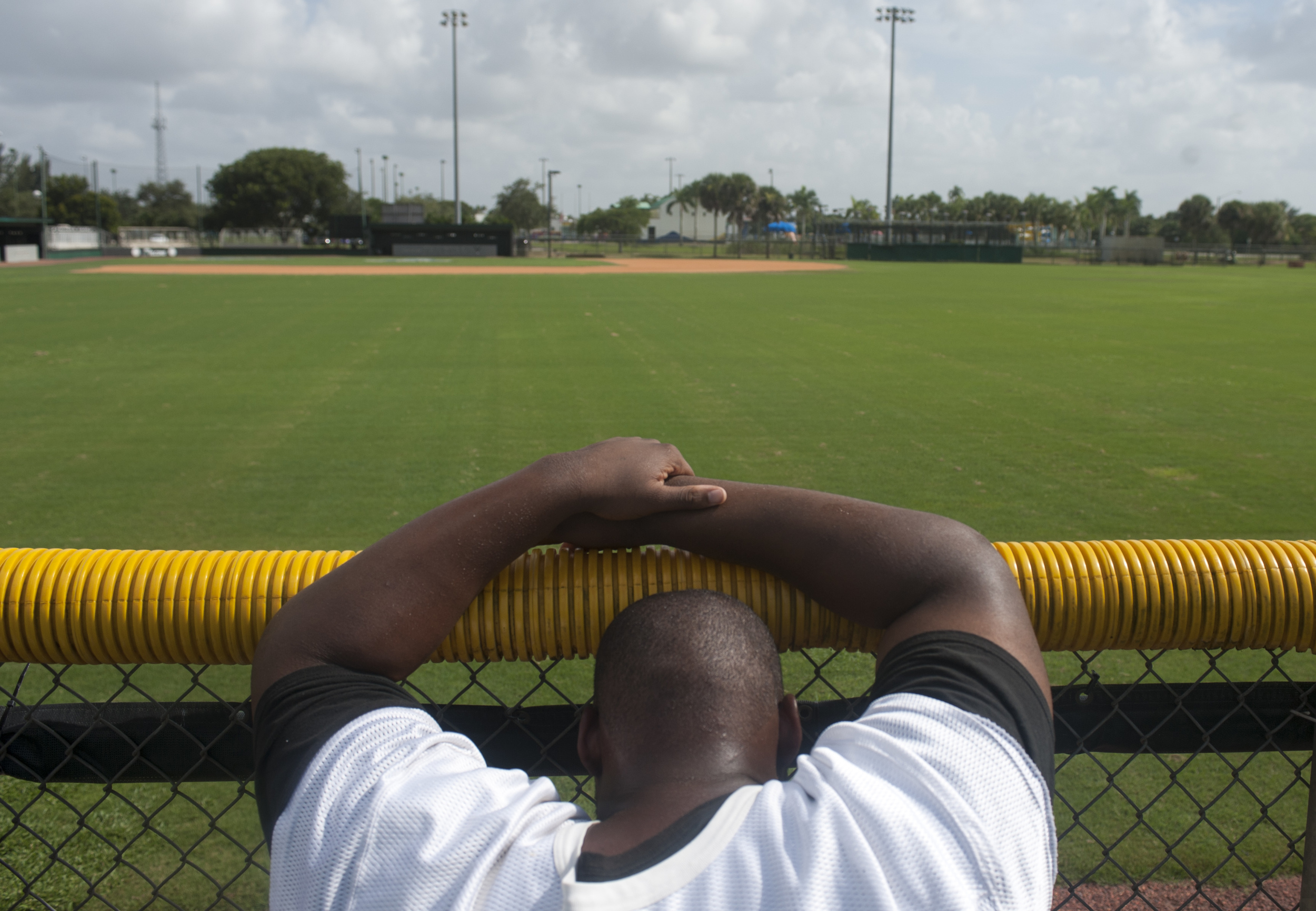Flanagan high school senior offensive lineman Jamar Lambert leans on a fence after finishing wind sprints during the first practice of the high school football season at Flanagan High School on Monday, Aug. 1, 2016. The reigning state champions look to repeat again despite the loss of key players from last year.