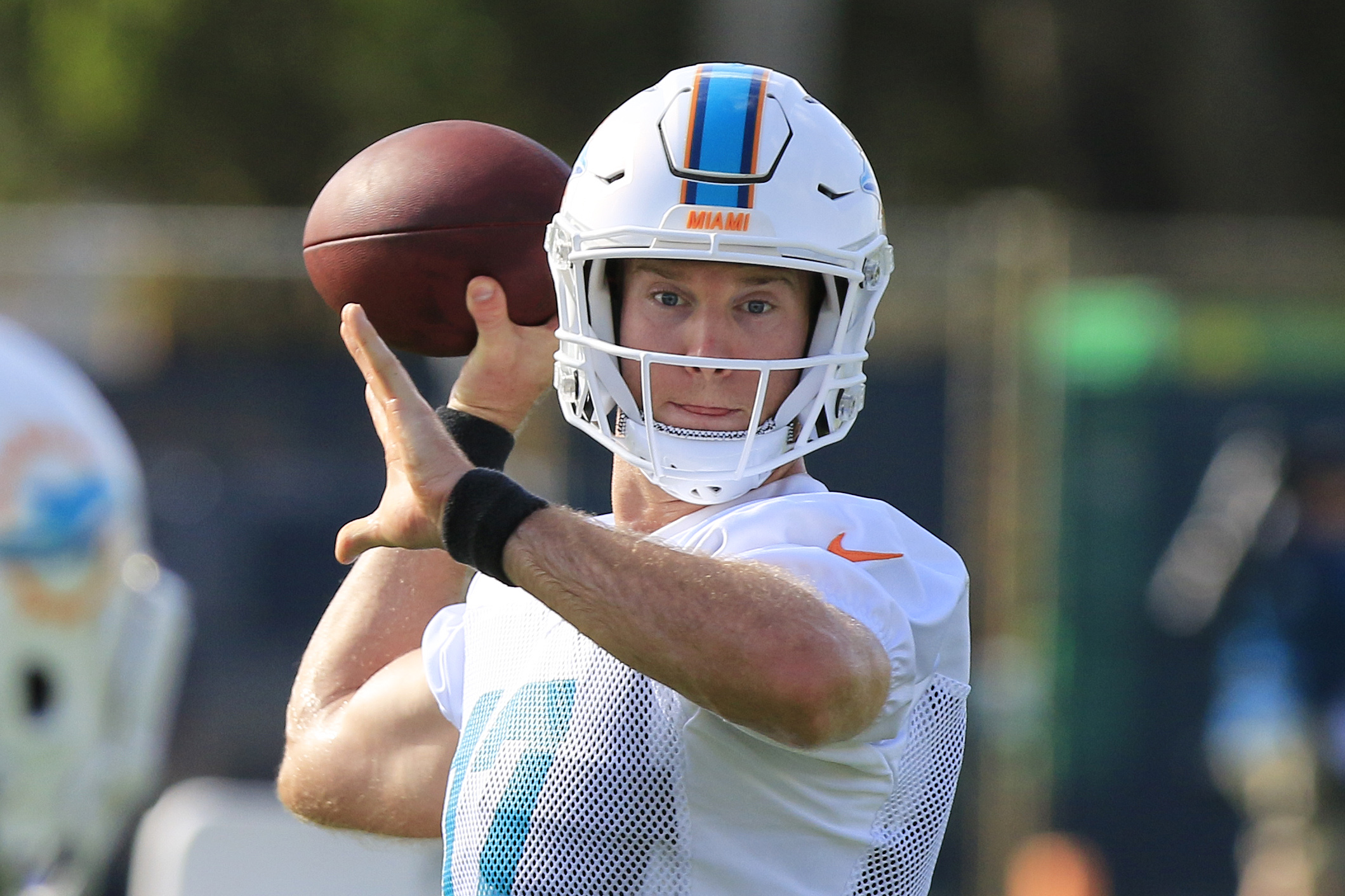 Miami Dolphins quarterback Ryan Tannehill (17) makes a pass to Miami Dolphins running back Jay Ajayi (23) during the first day of Miami Dolphins training camp held at the Dolphins Training Facility on Friday, July 29, 2016.