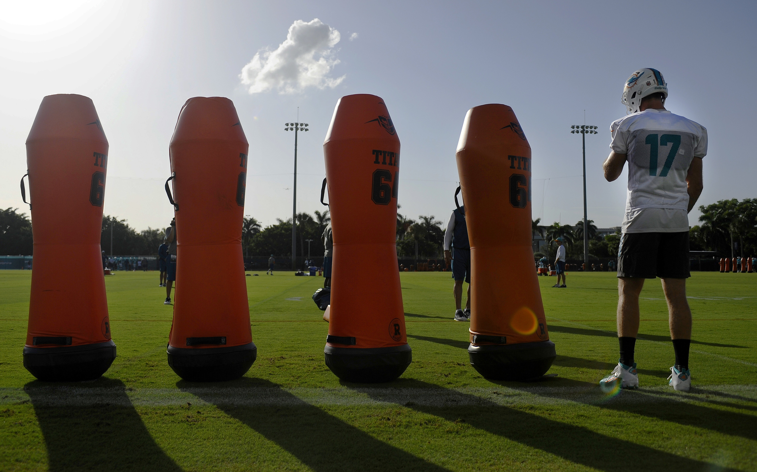 Miami Dolphins quarterback Ryan Tannehill (17) awaits to start a new passing drill during the second day of Miami Dolphins training camp held at the Dolphins Training Facility on Saturday, July 30, 2016.