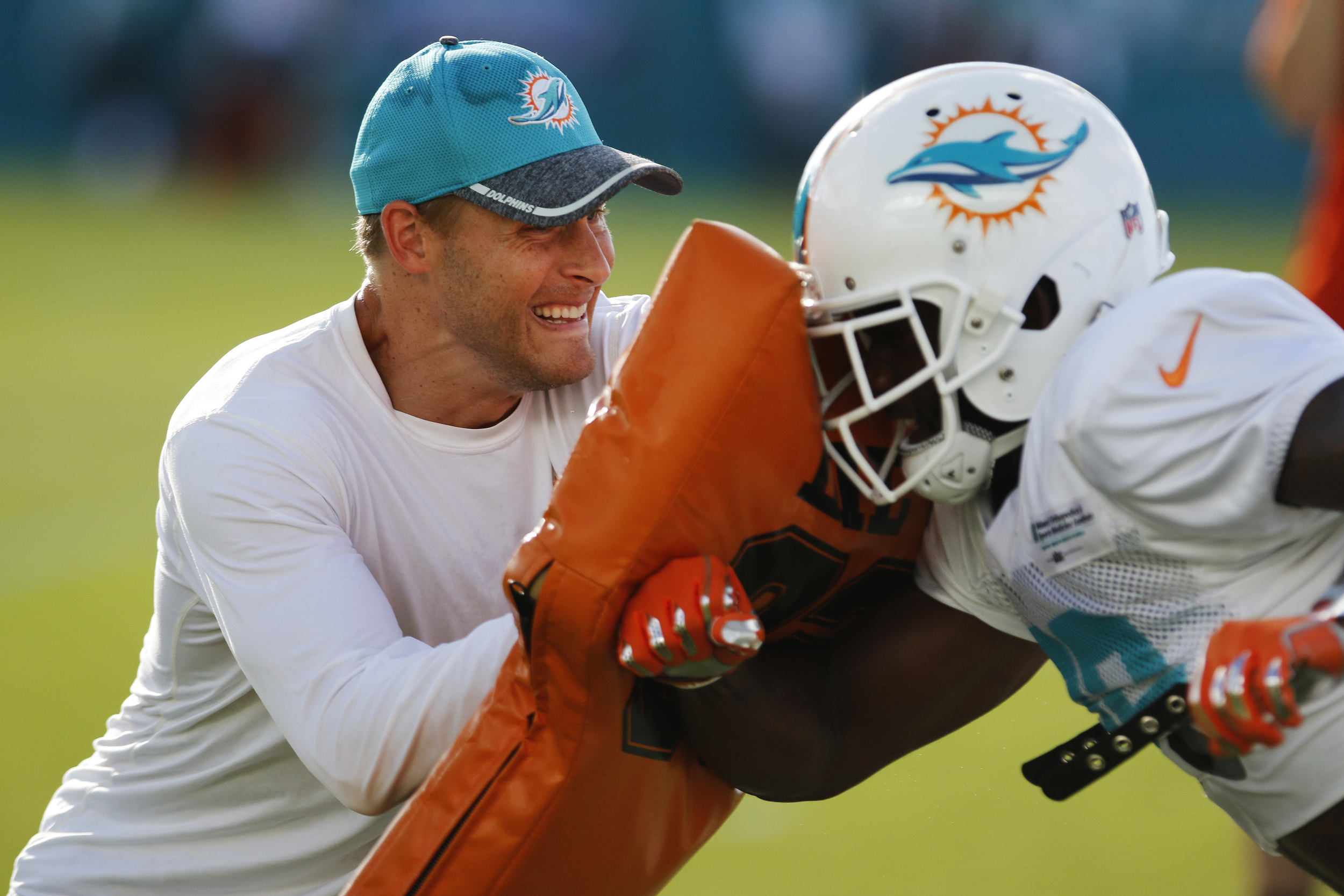 Assistant wide receivers coach Ben Johnson goes through drills during day three of the Miami Dolphins training camp held at the Dolphins Training Facility on Sunday, July 31, 2016.
