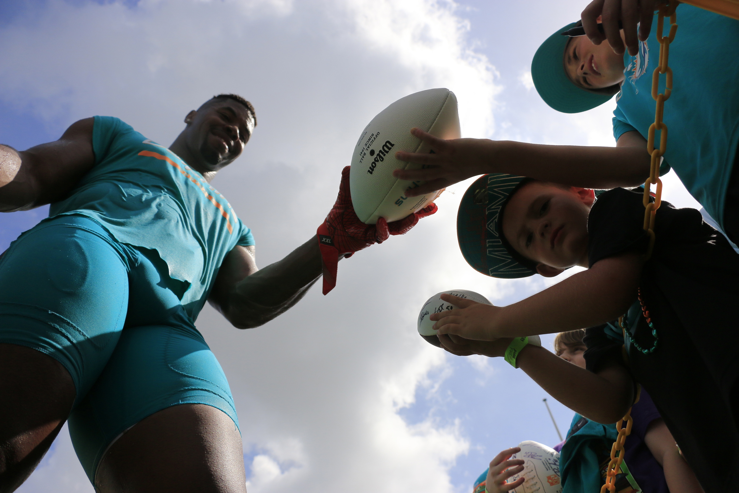 Miami Dolphins defensive end Cameron Wake (91) signs autographs after the first day of Miami Dolphins training camp held at the Dolphins Training Facility on Friday, July 29, 2016.