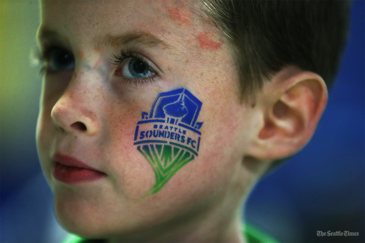 Campbell Duggan, 7, of Tacoma waits to get a balloon prior to Seattle's game against FC Dallas in the first leg of the MLS Western Conference semifinals held at CenturyLink Field on Sunday, October 30, 2016. The winner will move on to play in the conference finals.