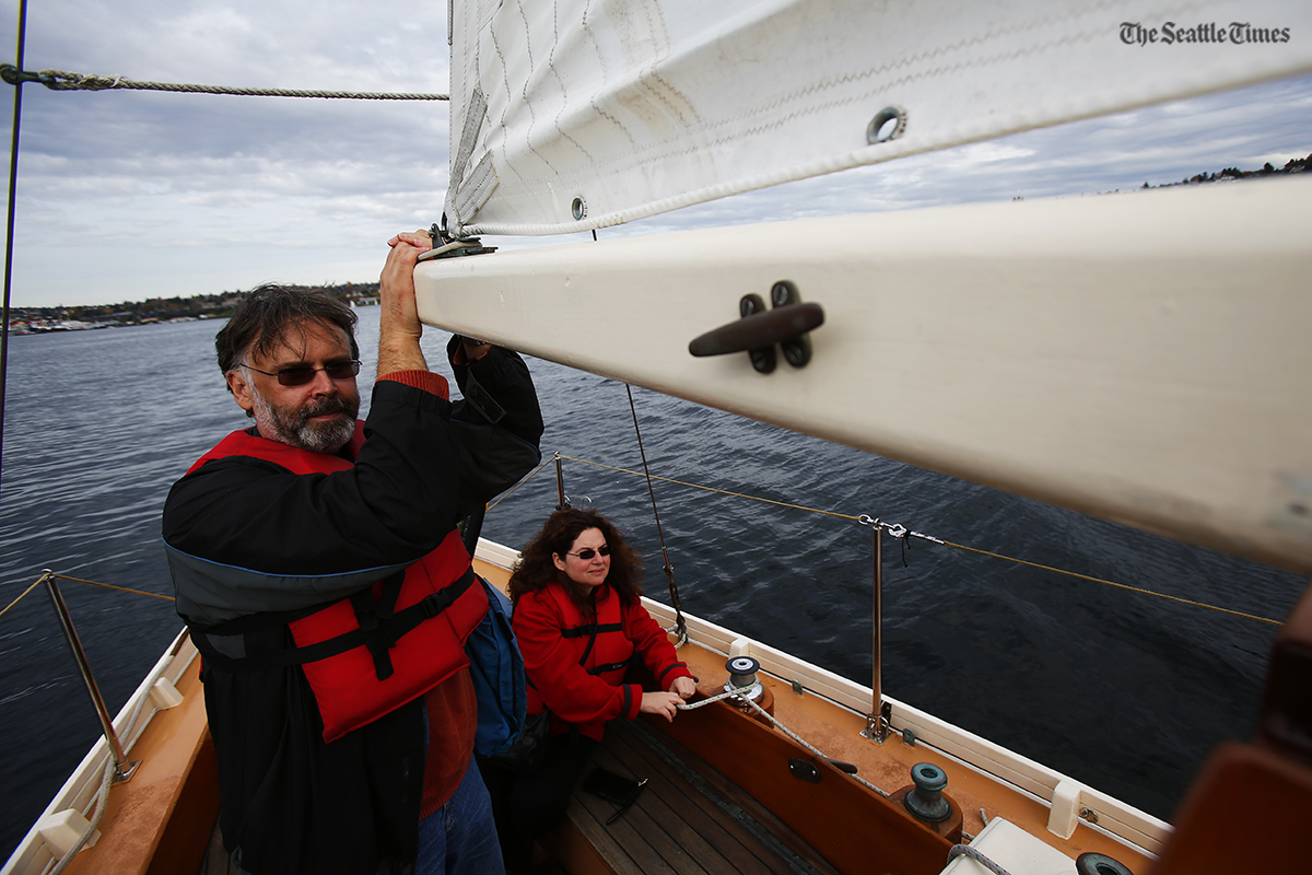 Thomas Wilkop of Woodland, California, helps rotate the sails while on Lake Union on Sunday, October 23, 2016. Every Sunday visitors are given a free chance learning how to sail as well as seeing the Seattle skyline while in classic boats around Lake Union at The Center for Wooden Boats.