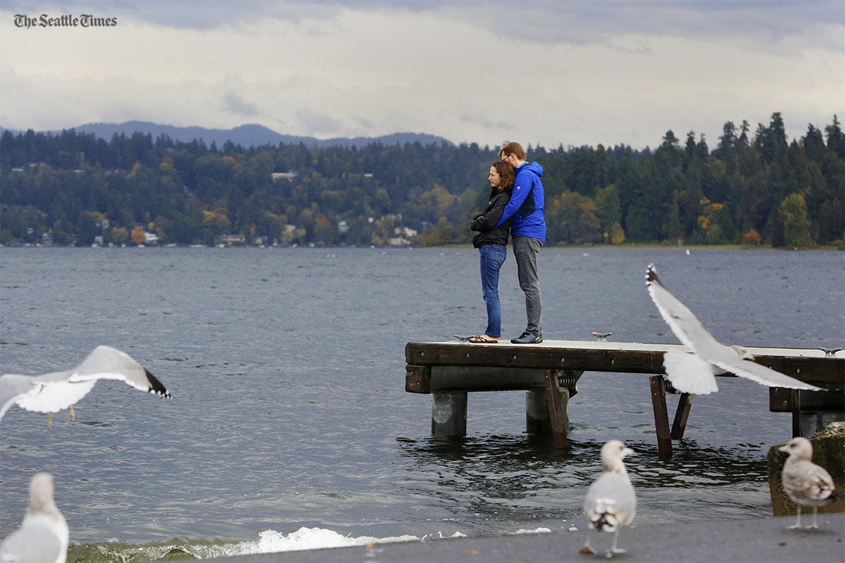Adam Tycaster embraces his wife Laura Tycaster at a pier near Seward Park on Saturday, October 15, 2016. Strong winds and heavy rain is expected to hit the northwest caused by remnants of a typhoon.