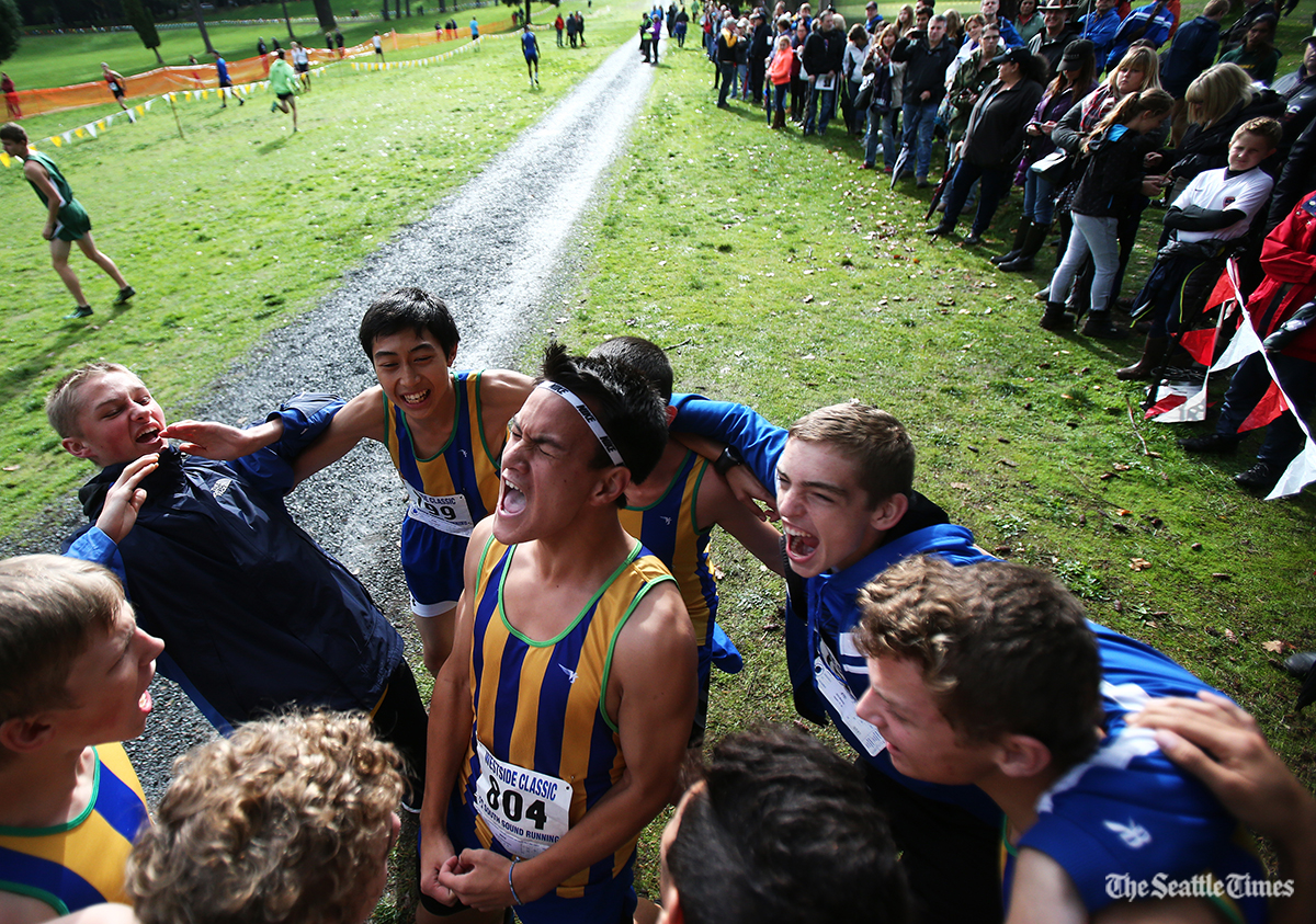 The Hazen High School boys team gets pumped up prior to their class 4A race during the Westside Classic District cross country meet at the American Lake Golf Course in Lakewood on Saturday, October 29, 2016.