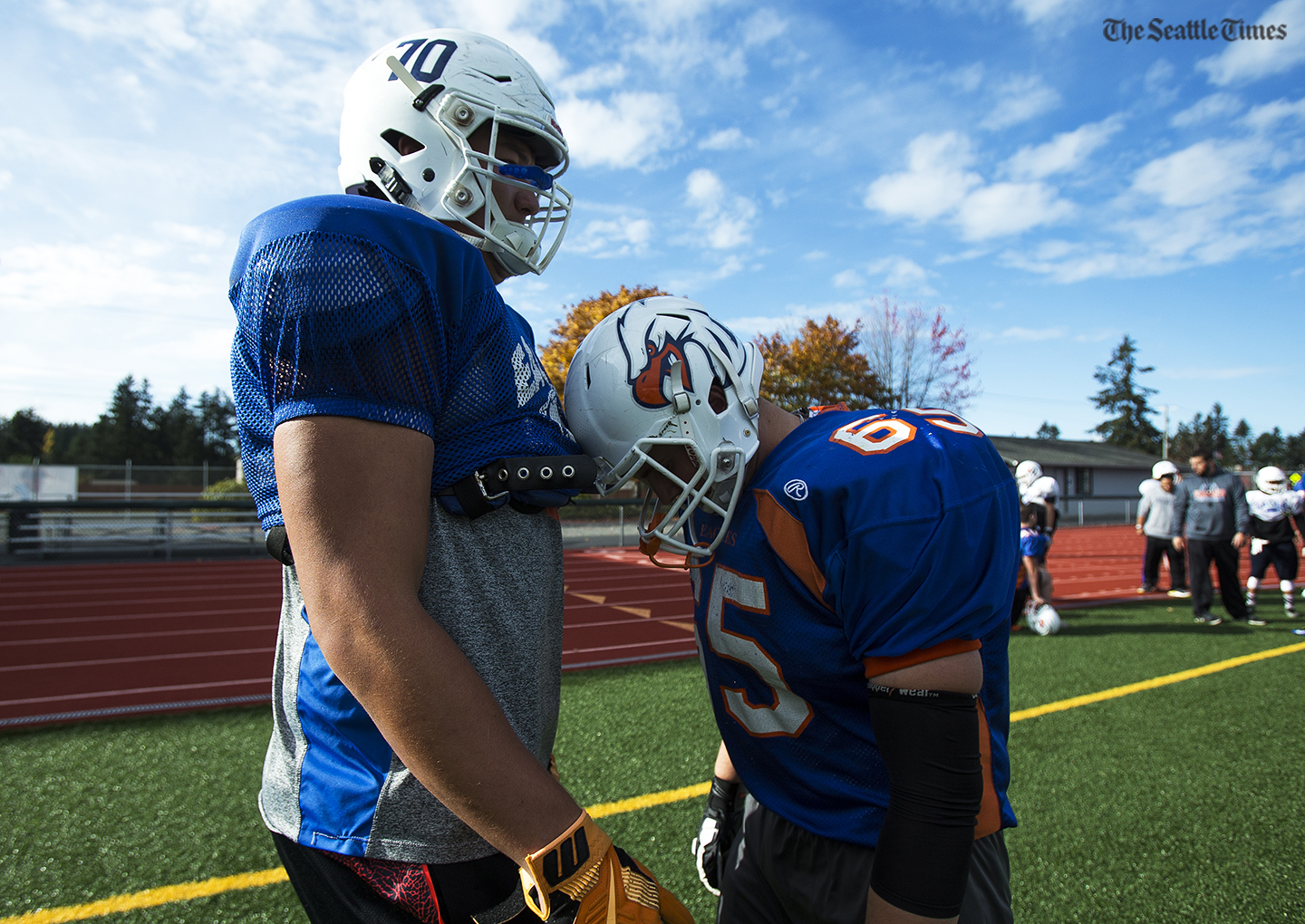 Graham-Kapowsin high schools Foster Sarell, who is the top-rated high school offensive lineman in the nation, shares a moment with a teammate during practice at Bethel High School in Spanaway on Tuesday, 25, 2016.