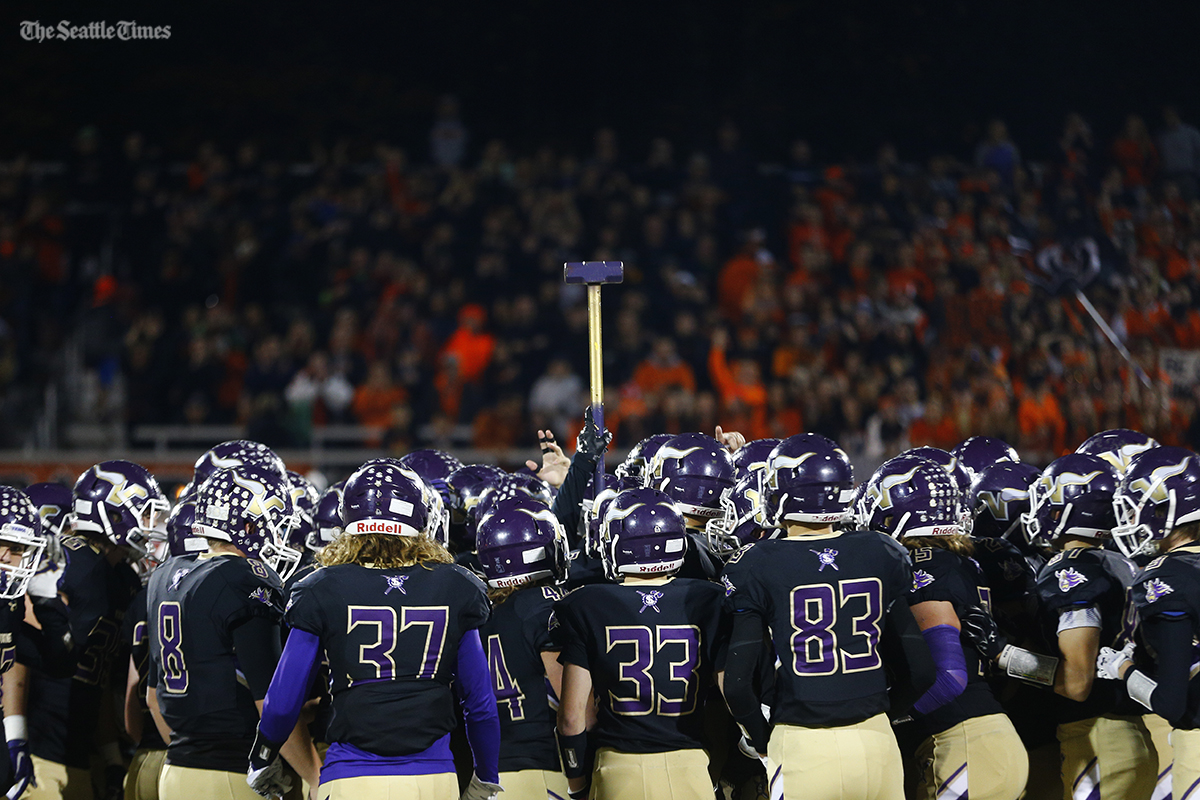 The Lake Stevens Vikings football team gathers at center field prior to their rivalry game against Monroe at Lake Stevens High School on Friday, October 28, 2016.