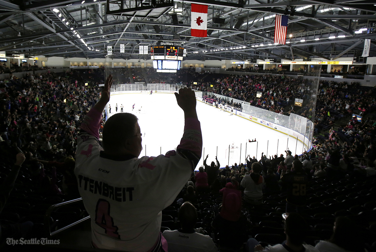 Seattle Thunderbirds fan Donald King of Renton, Washington, celebrates after a first period goal against rivals Portland Winterhawks on Friday, October 21, 2016, at the ShoWare Center.