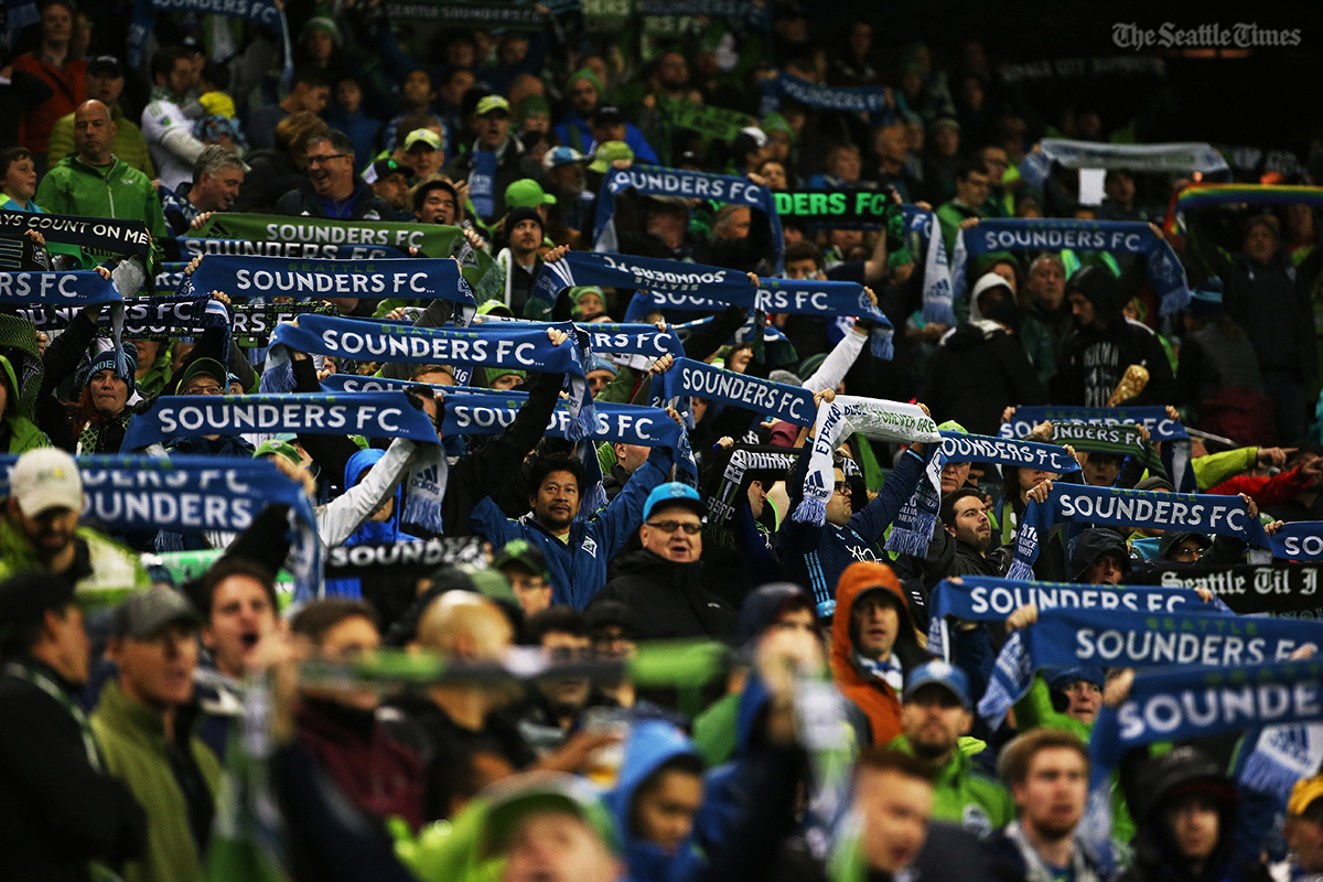 Fans hold up their scarves during the first half of their game against FC Dallas in the first leg of the MLS Western Conference semifinals held at CenturyLink Field on Sunday, October 30, 2016. The winner will move on to play in the conference finals.