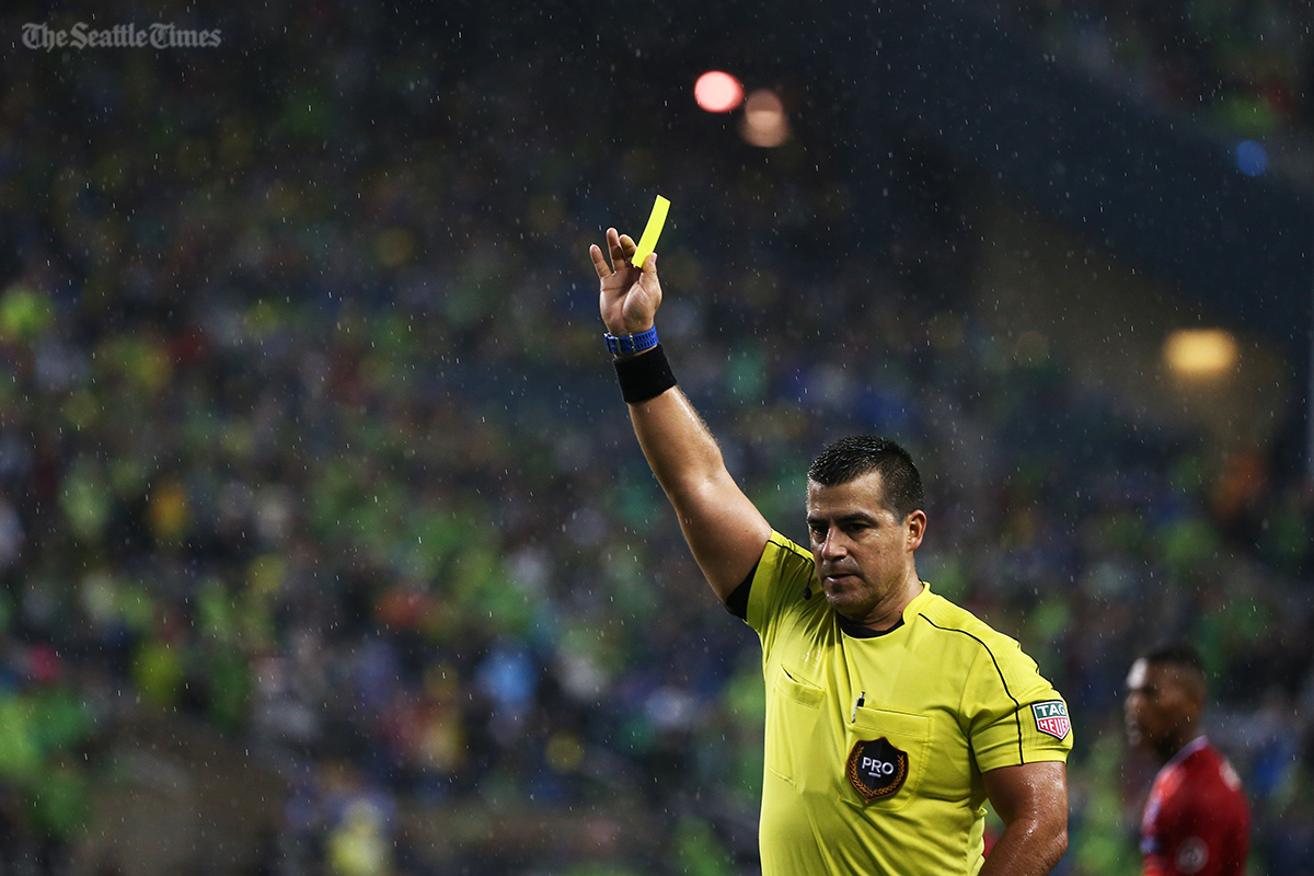 The referee gives out the only card of the game during the second half against FC Dallas in the first leg of the MLS Western Conference semifinals held at CenturyLink Field on Sunday, October 30, 2016. The Sounders fended off Dallas 3-0 to move on to the conference finals.