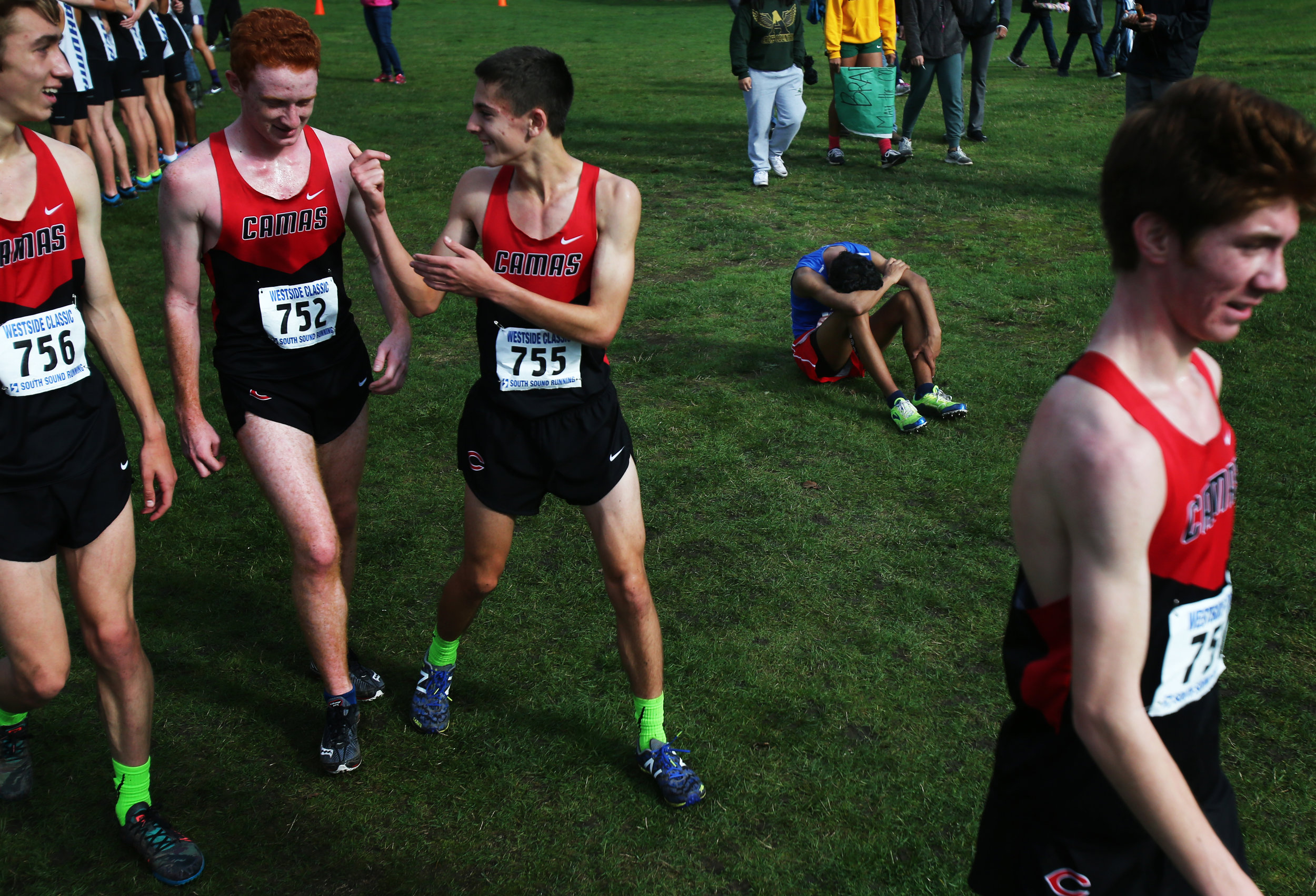 Senior at Cameridian High School Adonis Rosabal gets emotional after his last race during the Westside Classic District cross country meet at the American Lake Golf Course in Lakewood on Saturday, October 29, 2016.