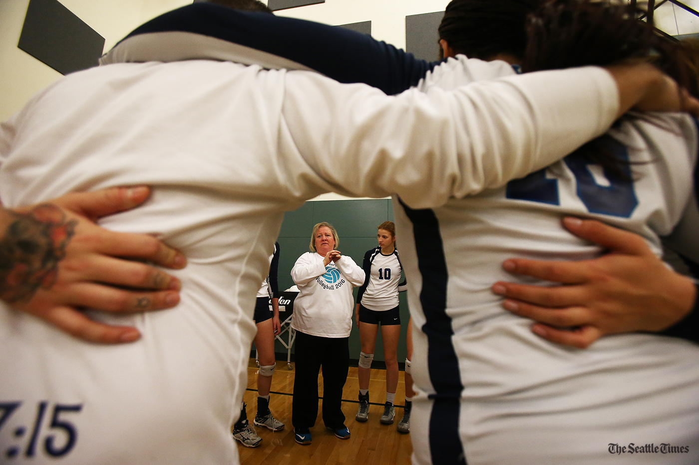Auburn Riverside assistant coach Stazi Edmonds talks to the team prior to their West Central District volleyball semifinal game against the Payallup Vikings held at Kentwood High School on Saturday, November 5, 2016.