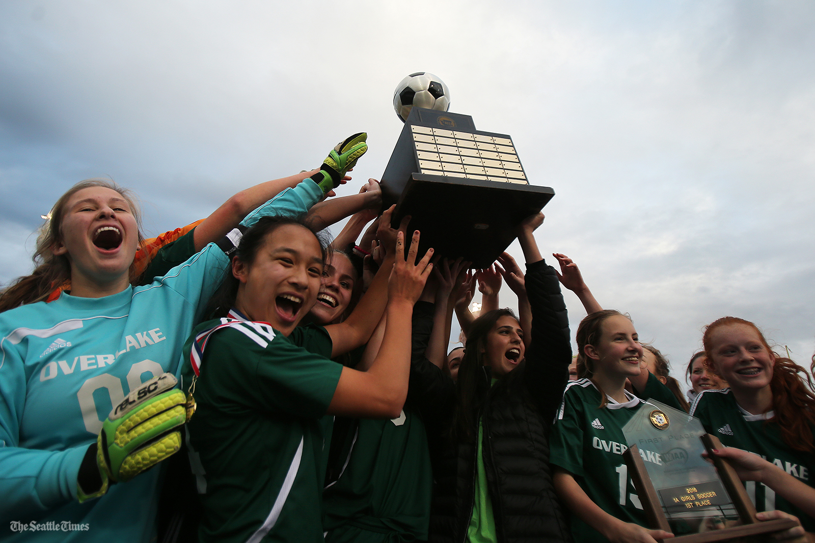 The Overlake High School women soccer team celebrates after winning the class 1A soccer state championship 3-1 over La Salle High School at Shoreline Stadium on Saturday, November 19, 2016.