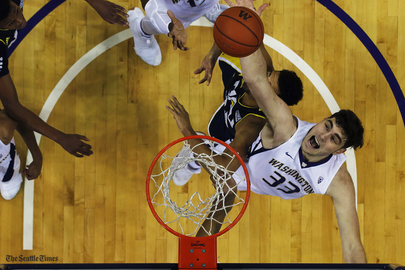 Washington Huskies forward Sam Timmins (33) goes up for a contested rebound during their game against Northern Arizona at the Hec Edmundson Pavilion on Sunday, November 20, 2016. The Huskies came out strong and ended stronger defeating the Lumberjacks 92-58.