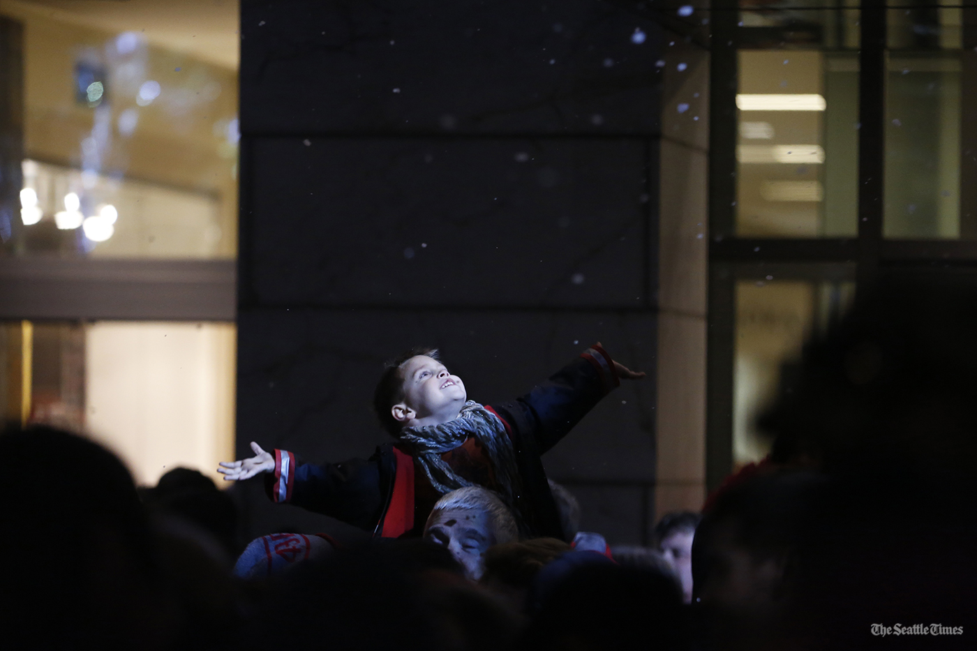 A young boy looks to catch fake snowflakesat Westlake Park prior to watching the annual lighting of the Westlake Center Tree as well as the famous 161-foot high, 3,600-bulb Holiday Star above Macy's on Friday, November 25, 2016.