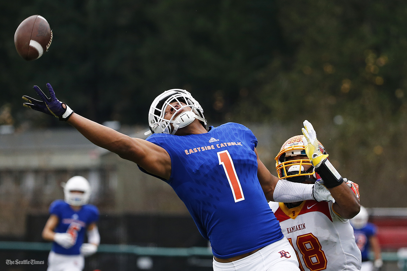 Eastside Catholic Crusader wide receiver Hunter Bryant looks to make a one-handed catch during the first half of their State semifinal game against the Kamiakin Braves held at Pop Keeney Stadium in Bothell on Saturday, November 26, 2016.