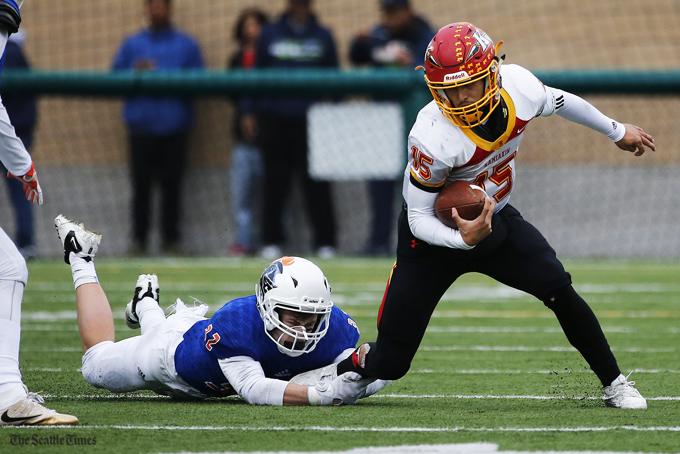 Kamiakin Braves quarterback Zach Borischbreaks free of a defender during the first half of their State semifinal game against the Eastside Catholic Crusaders held at Pop Keeney Stadium in Bothell on Saturday, November 26, 2016.