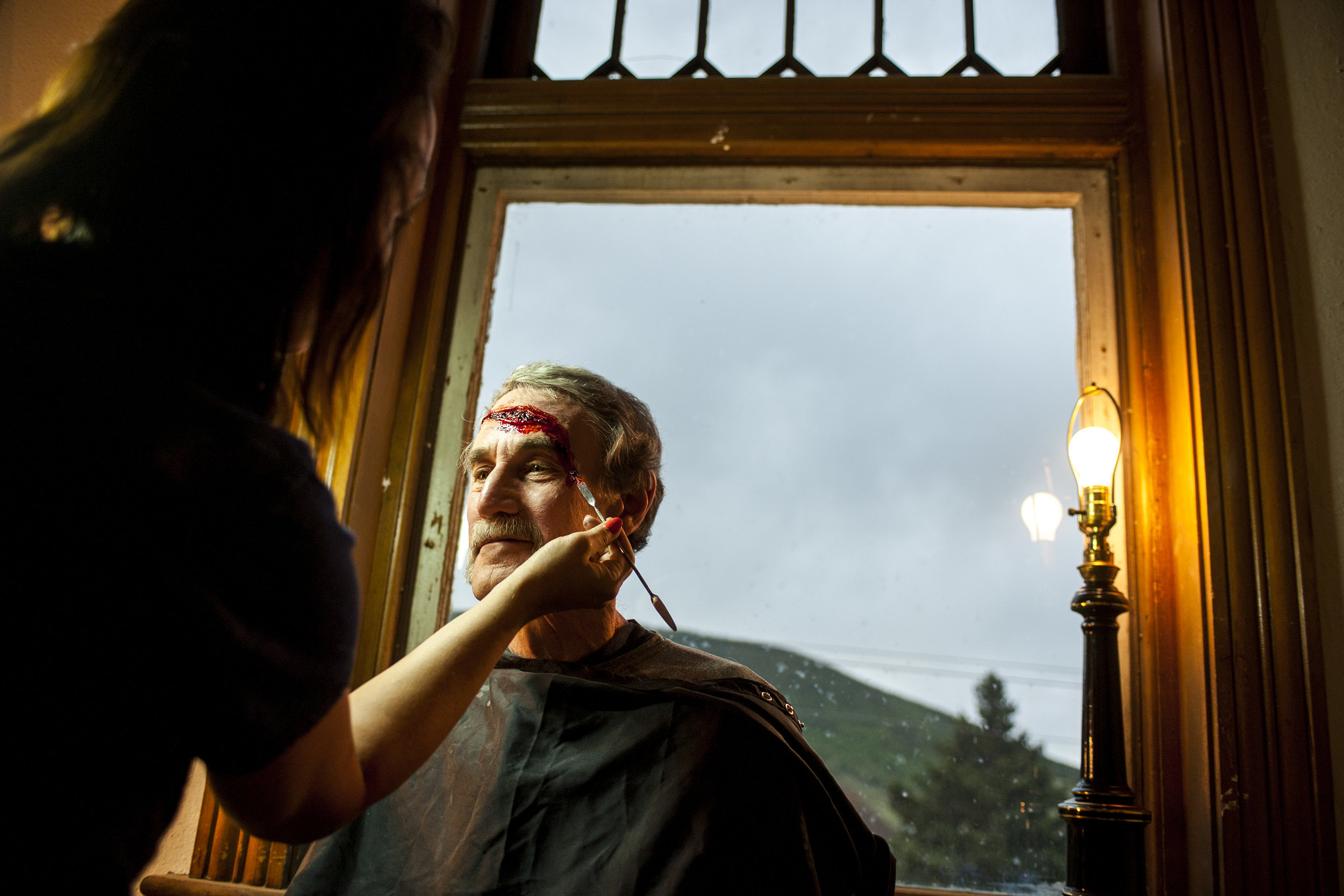 Sam Morrison of Victor, Colorado, has his makeup done prior to filming Carnival of Crime in Victor on Thursday, June 18, 2015. Twelve Victor residents have been chosen to play as extras in a film called Carnival of Crime which is a movie based off of the short story The Facts Concerning the Recent Carnival in Connecticut but Mark Twain.