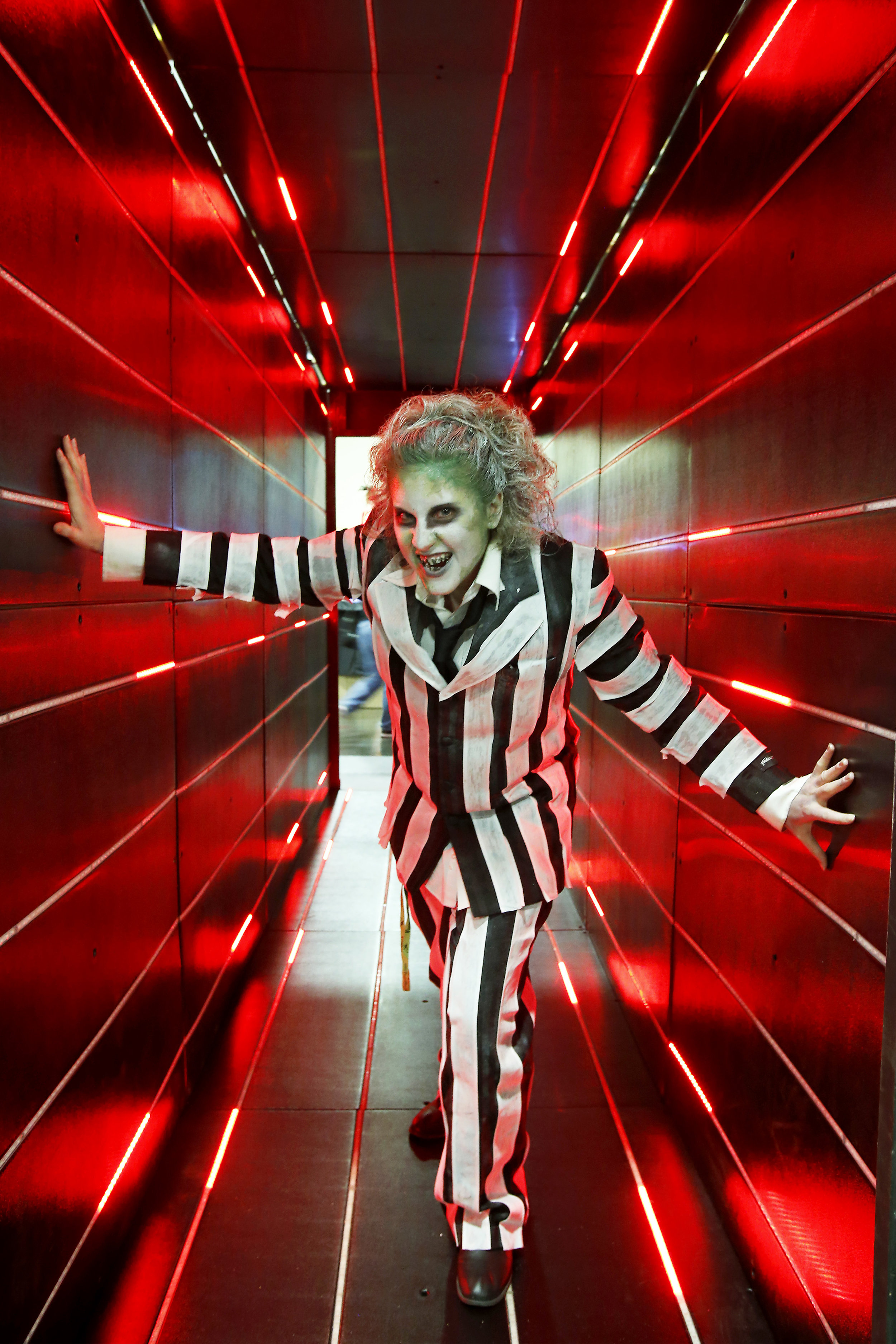 Emily Adelman of Grove City dresses as Beetlejuice at the annual Midwest Haunter Convention in the Greater Columbus Convention Center on Sunday, June 8, 2014. It took Adelman two and a half hours to put together her costume.