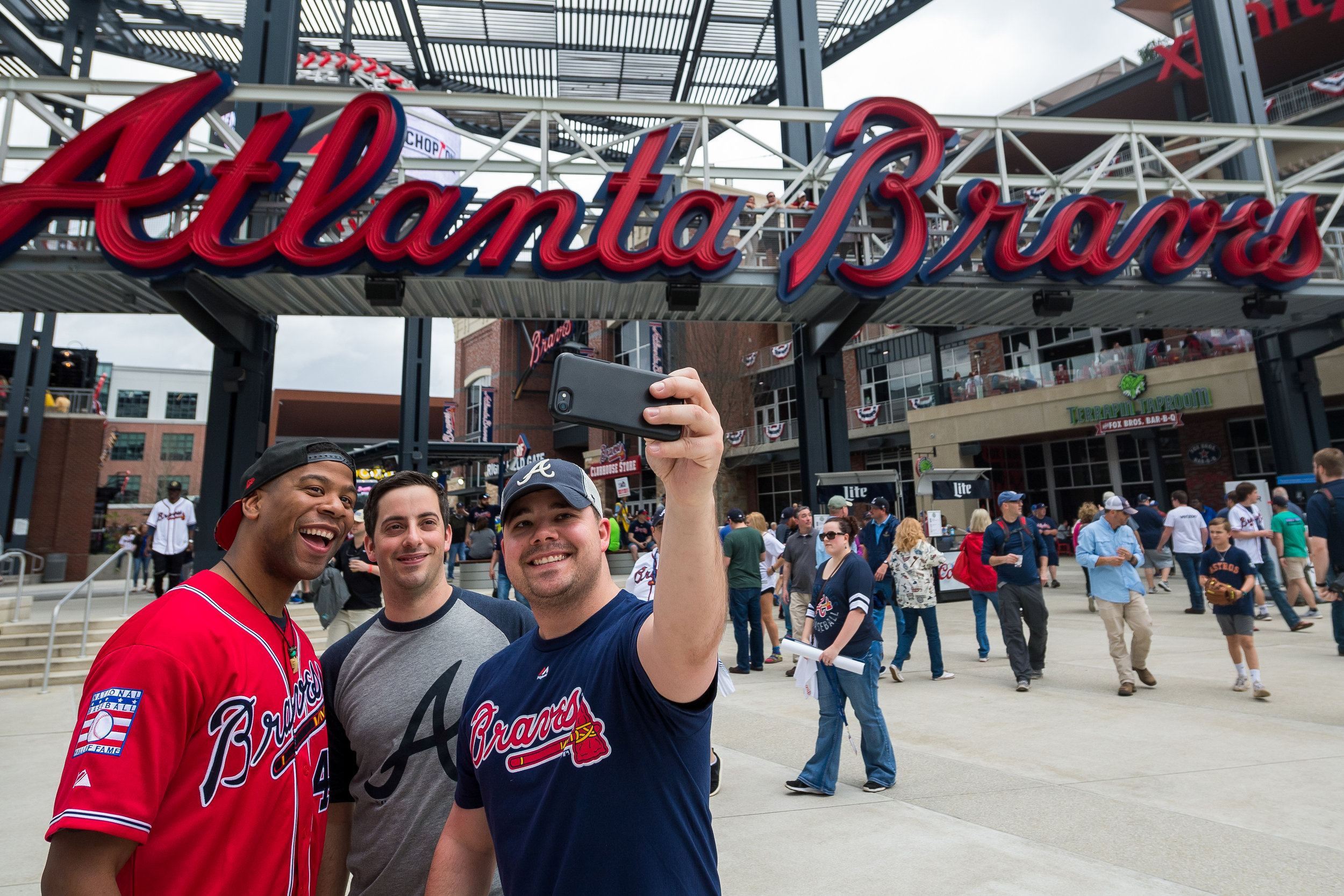 ATLANTA, GA - MARCH 29: Fans gather in Fan Plaza and The Battery before the game against the Philadelphia Phillies on Opening Day at SunTrust Park on March 29, 2018, in Atlanta, Georgia.