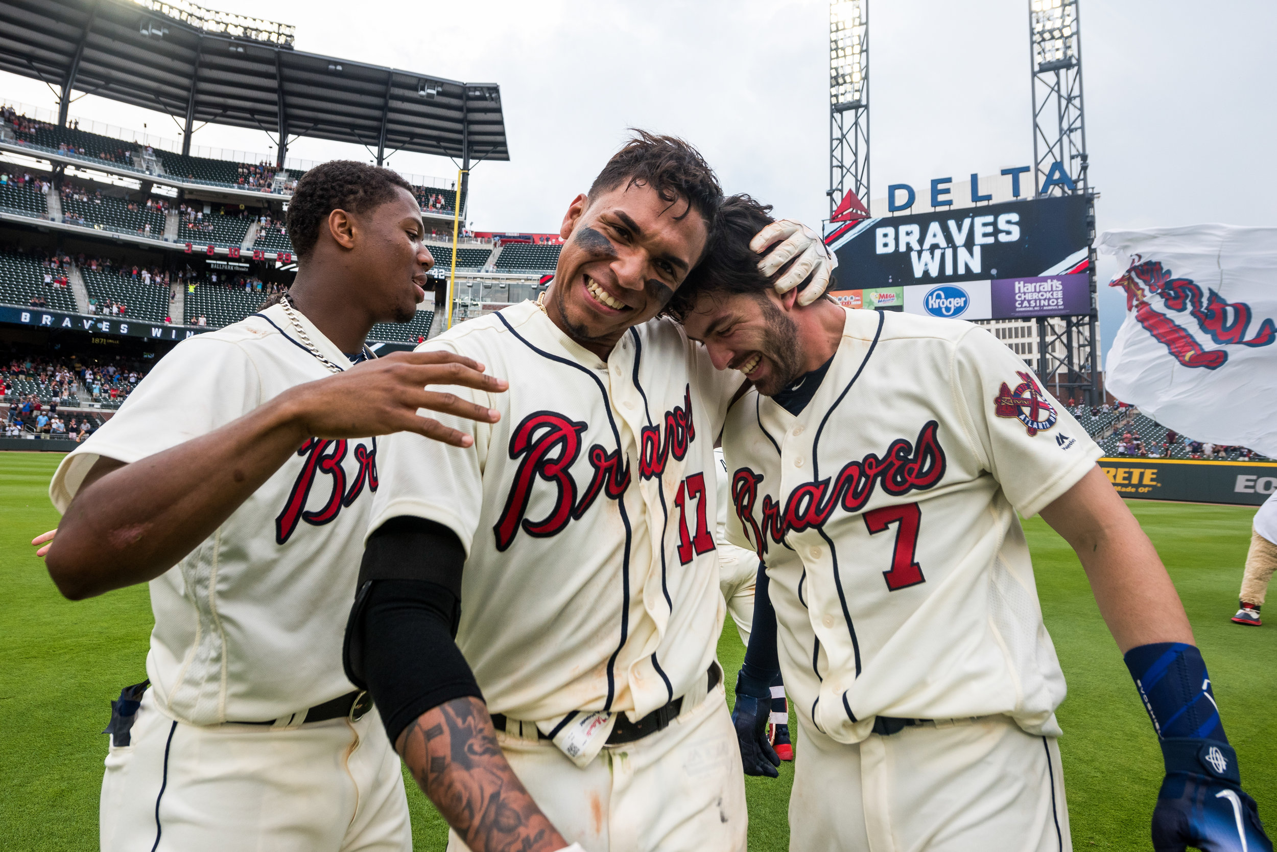 ATLANTA, GA - MAY 20: Dansby Swanson #7 and Johan Camargo #16 of the Atlanta Braves embrace after Inciarte hits a walk off run against the Miami Marlins at SunTrust Park on May 20, 2018, in Atlanta, Georgia. The Braves won on a walk off 10-9.