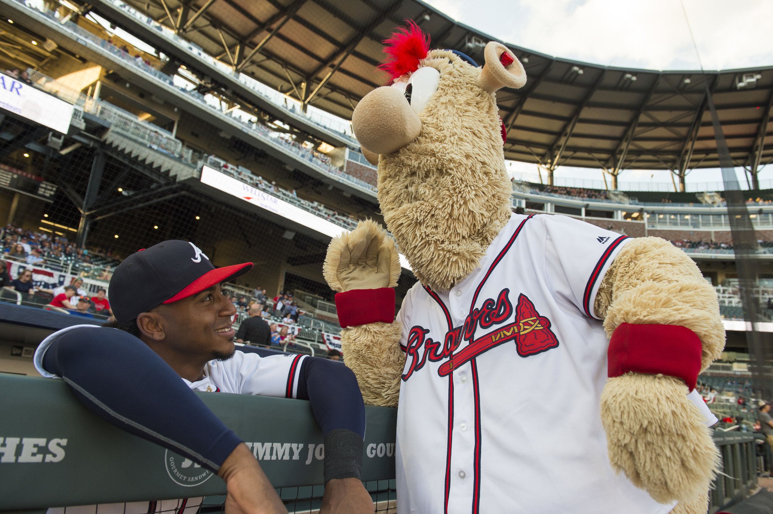 ATLANTA, GA - APRIL 03: Blooper and Ozzie Albies #1 of the Atlanta Braves chat before the game against the Washington Nationals on at SunTrust Park on April 3, 2018, in Atlanta, Georgia. The Braves won 13-6.