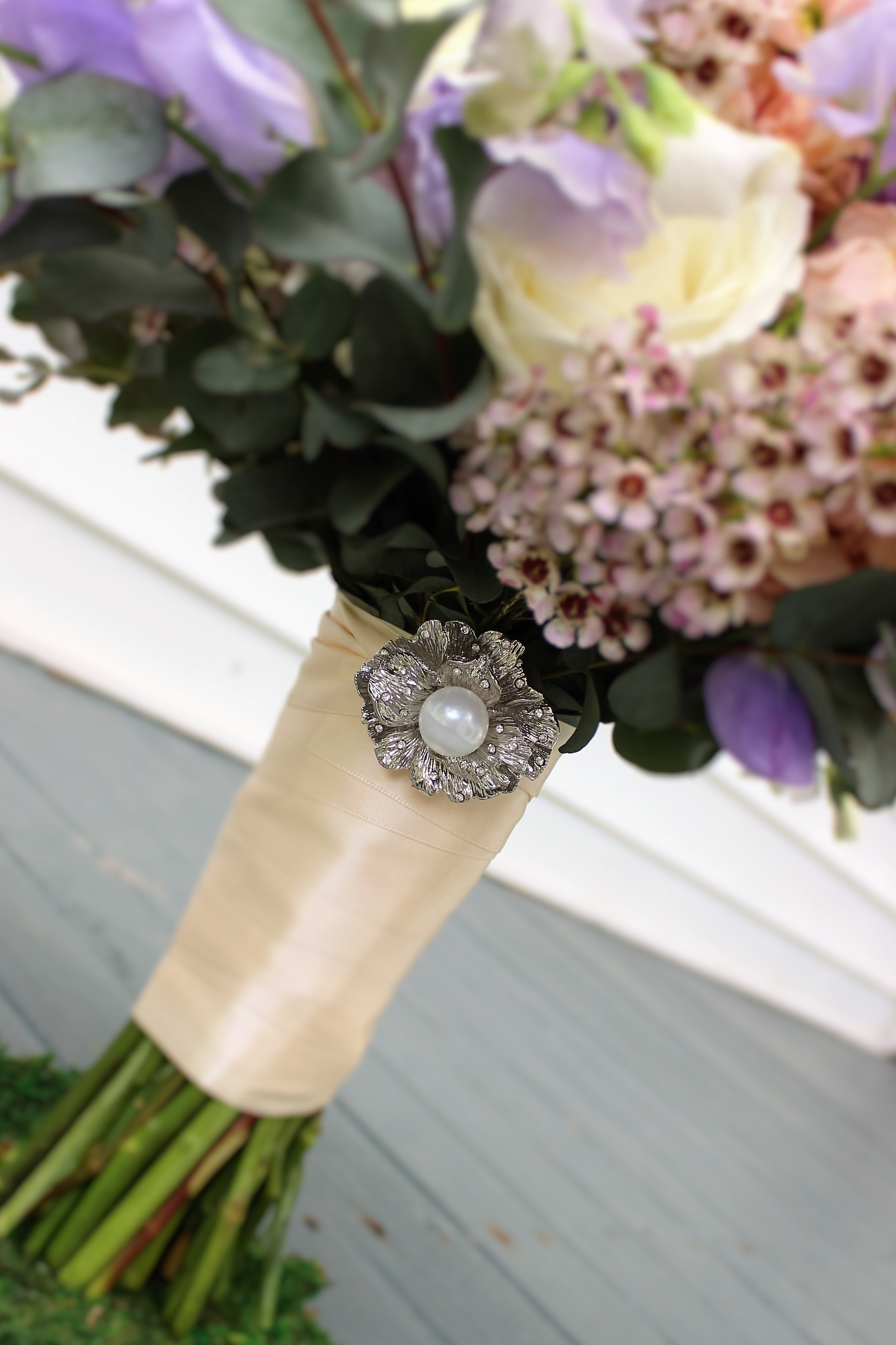 As a thank you, we add a sparkling keepsake brooch to all of our bride's bouquets! Each one is different and is chosen based on the bride's style.   Photo by The Floral Cottage