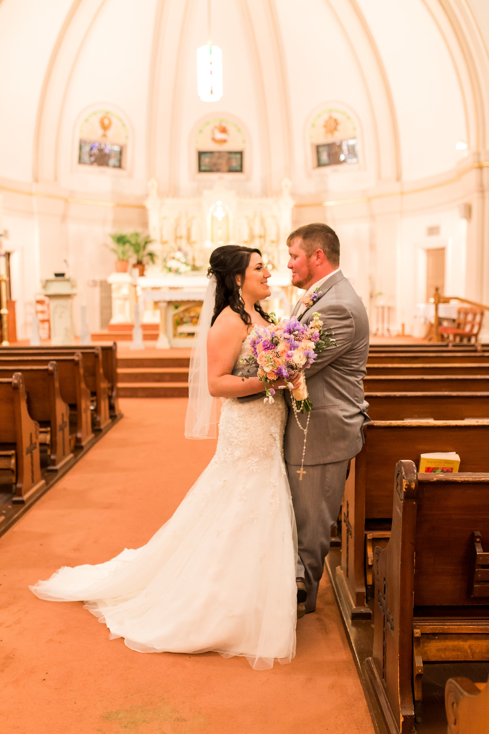 Adding a rosary to the bride's bouquet is a tradition among Catholic brides in Louisiana. We can also add a bit of lace from the bride's dress, a strand of pearls or memory photos to the bridal bouquet.   Photo by Kaylie Nicole Photography