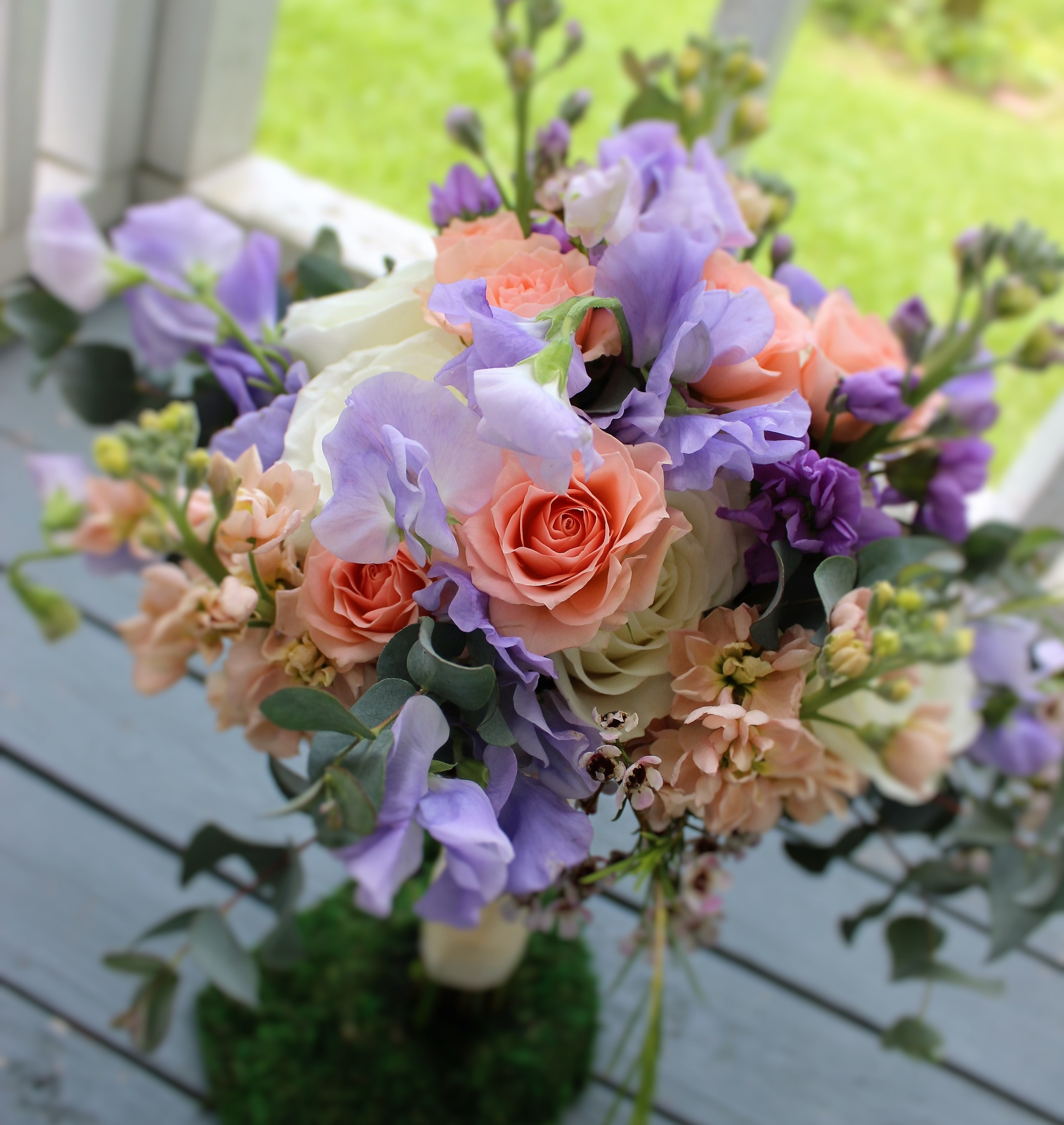 For the bridesmaids, the bride chose a smaller version of her bouquet. Just look at that dainty sweet pea in the center!   Photo by The Floral Cottage