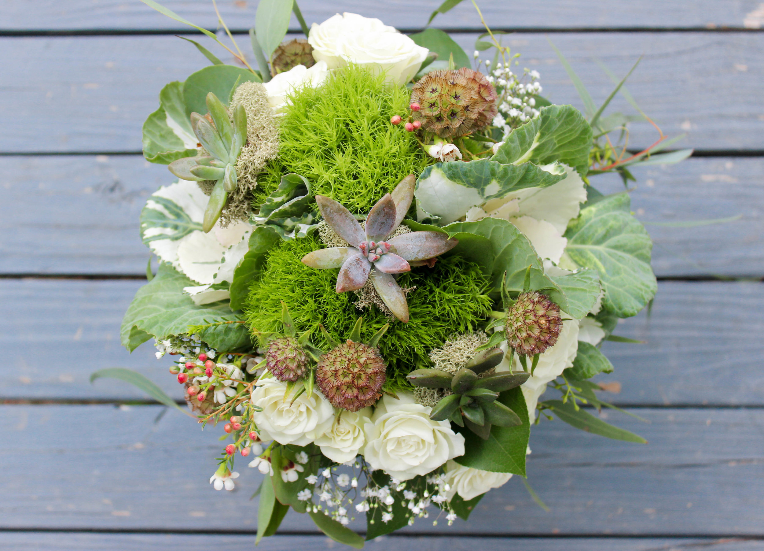 The green trick added that mossy texture to the bridemaids' bouquets along with a little deer moss. These gals look like they were just plucked from the Louisiana swamp!