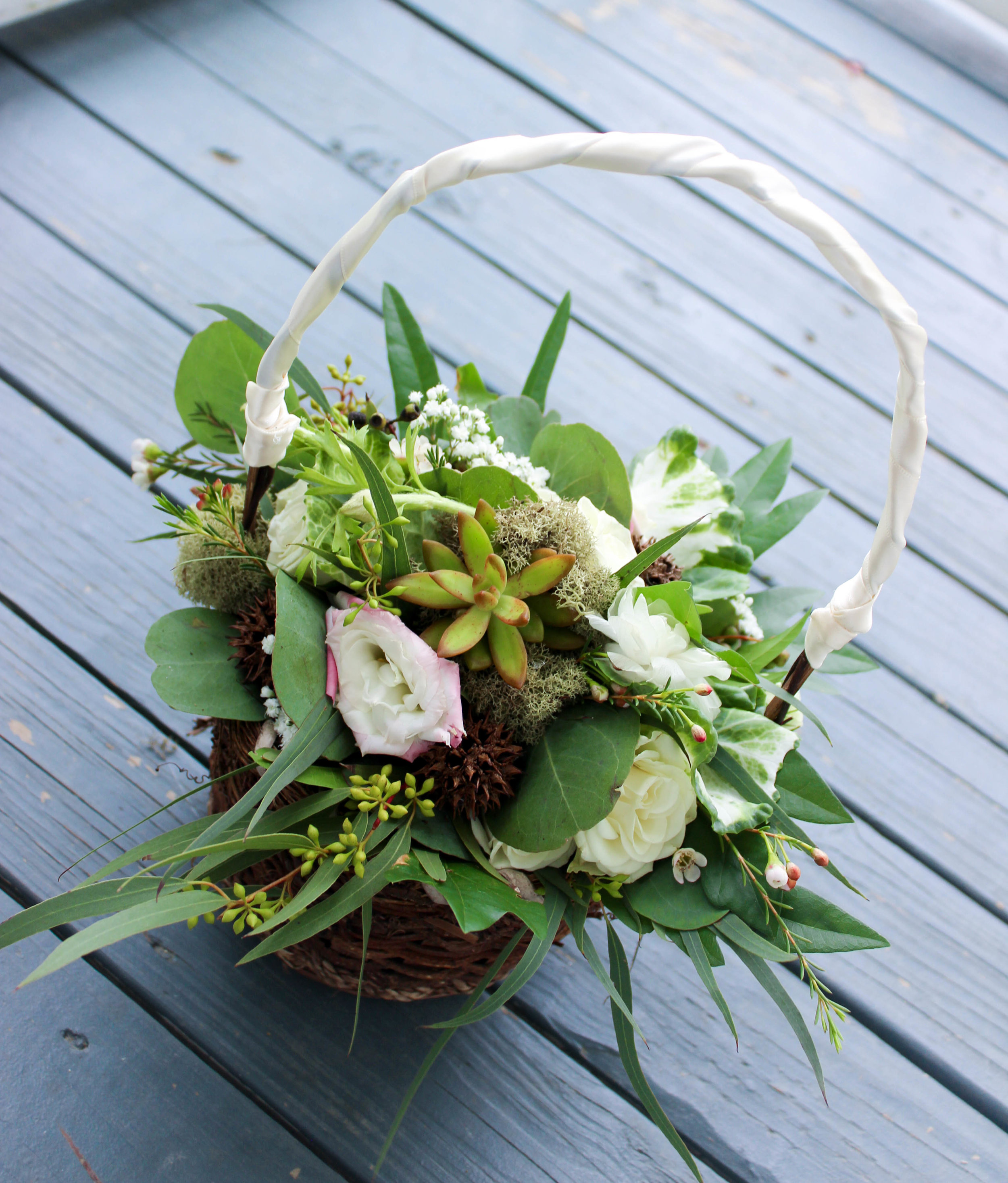 For the flower girl, a basket filled with matching foliage and flowers!